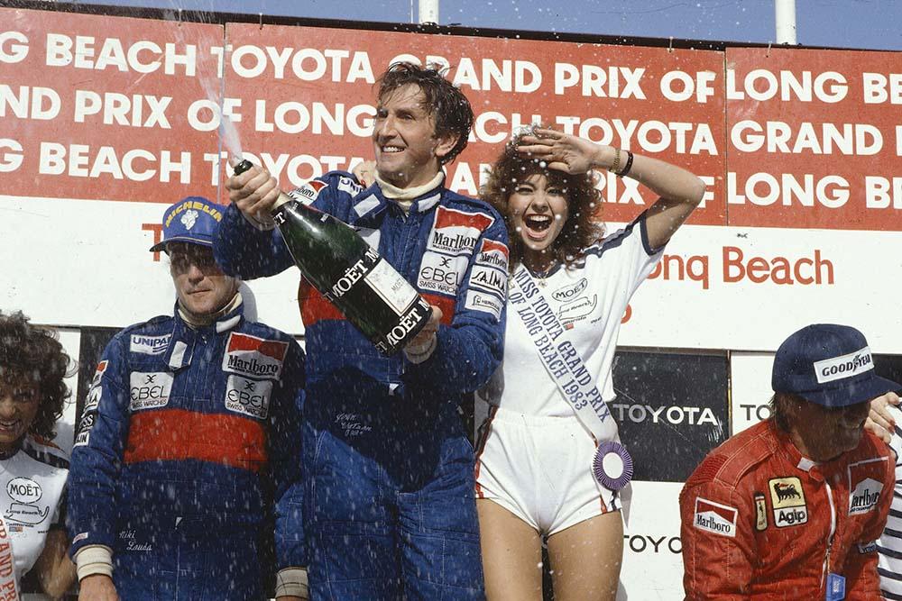 Winner John Watson, Niki Lauda 2nd position and Rene Arnoux 3rd position on the podium.