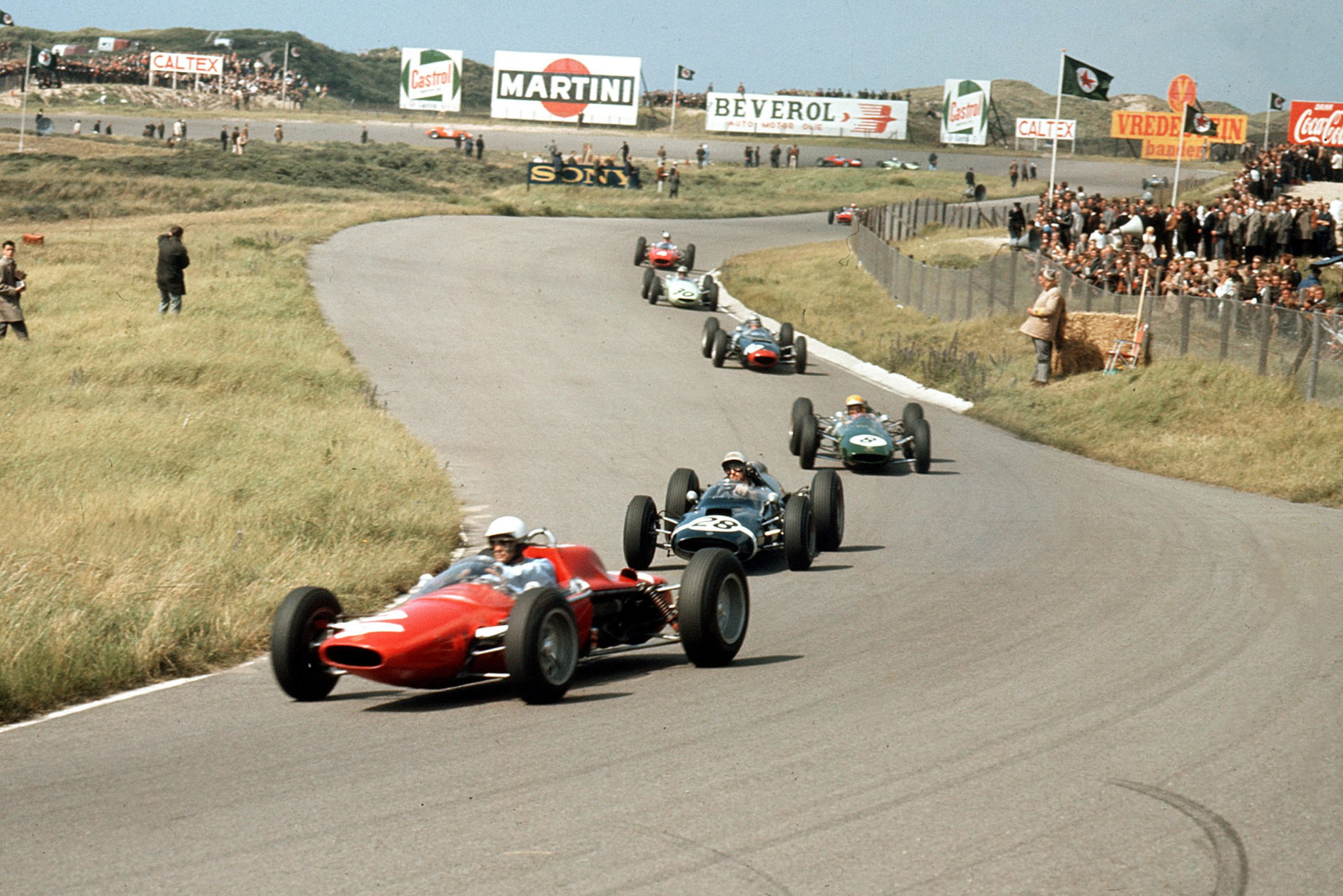 Phil Hill in an ATS 100 leads Jo Bonnier in a Cooper T60 Climax, Trevor Taylor in a Lotus 25 Climax, Chris Amon in a Lola Mk4A Climax and Innes Ireland driving a BRP 1-BRM.