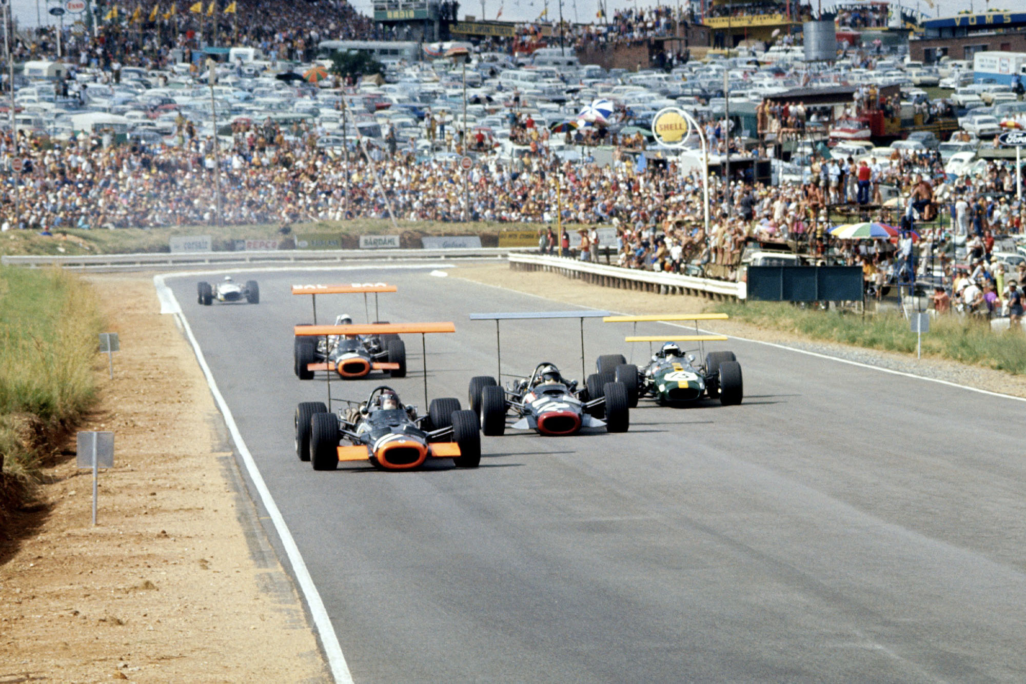Jackie Oliver (BRM) battles with Pedro Rodriguez (BRM) and Jacky Ickx (Brabham).