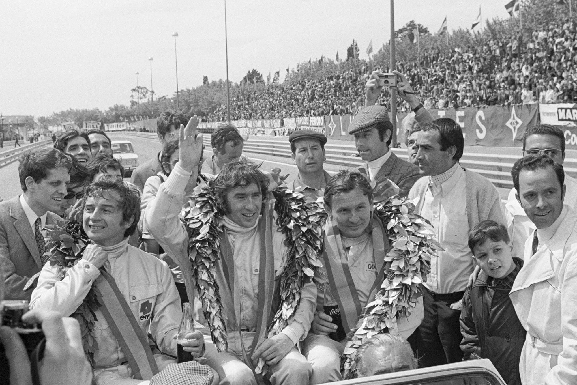 Jackie Stewart celebrates winning the 1969 Spanish Grand Prix.