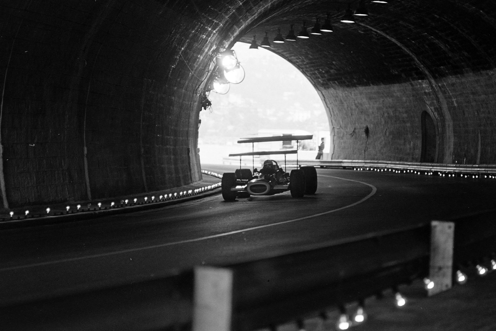 A Lotus blasts through the tunnel.