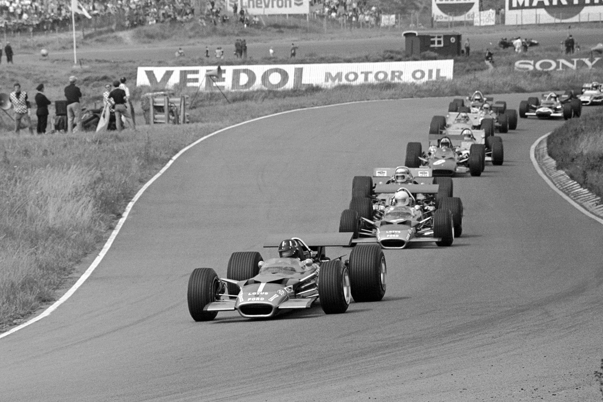 The field threads through the opening turns of Zandvoort at the 1969