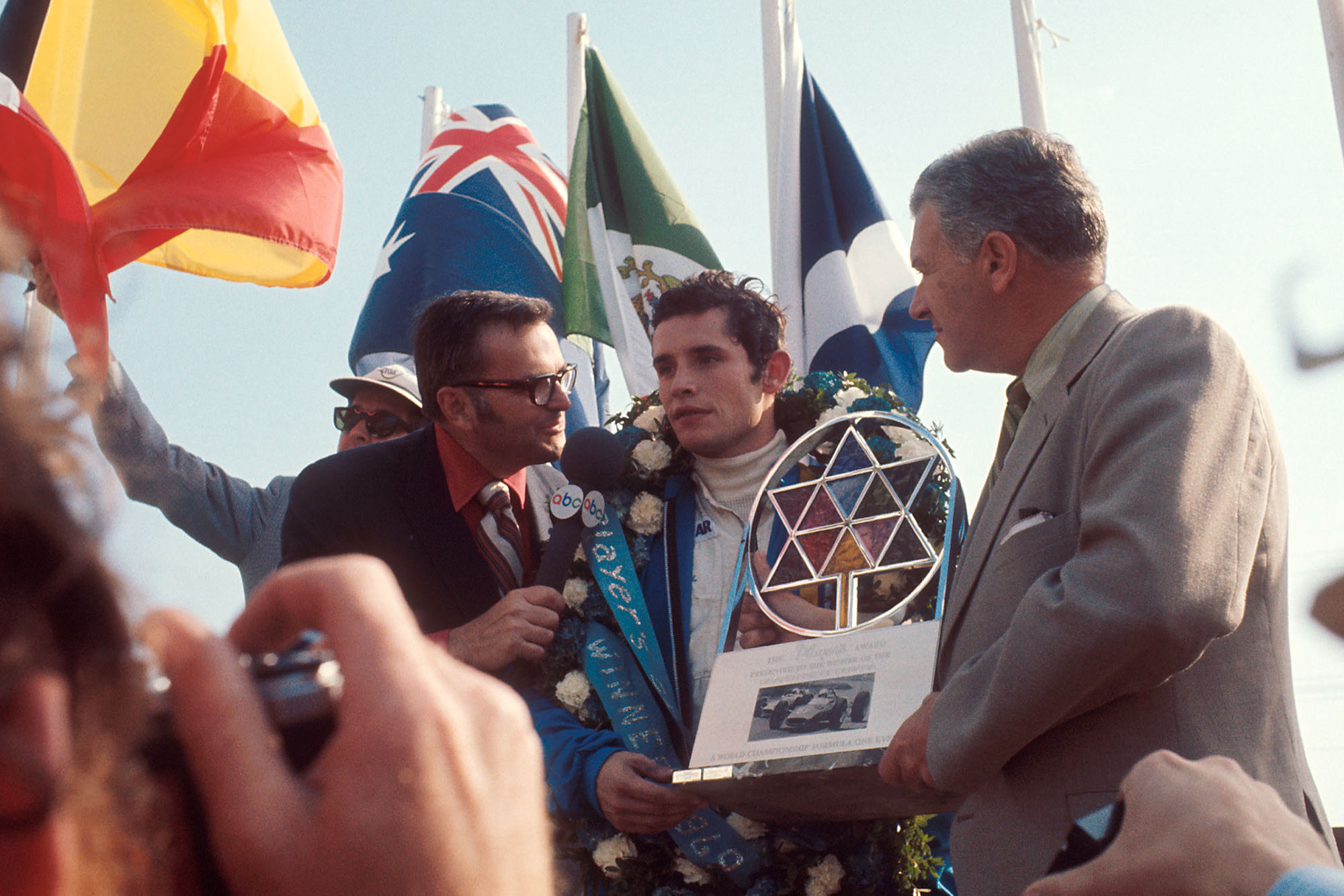 Jacky Ickx is interviewed on the podium after winning the 1969 Canadian Grand Prix