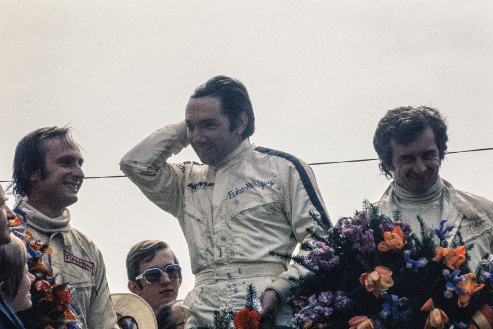 BRM's Pedro Rodriguez stands on the podium after winning the 1970 Belgian Grand Prix.