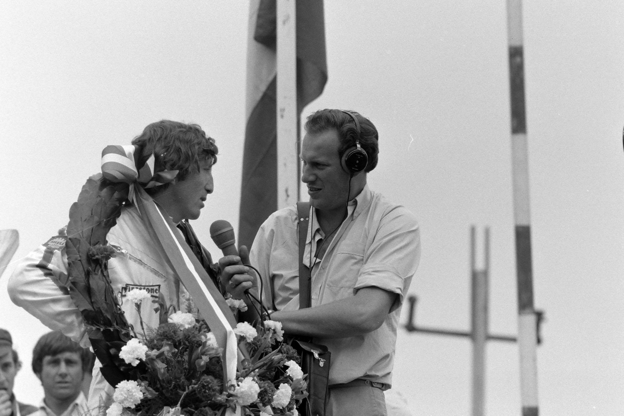 Lotus' Jochen Rindt is interviewed on the podium after winning the 1970 Dutch Grand Prix.