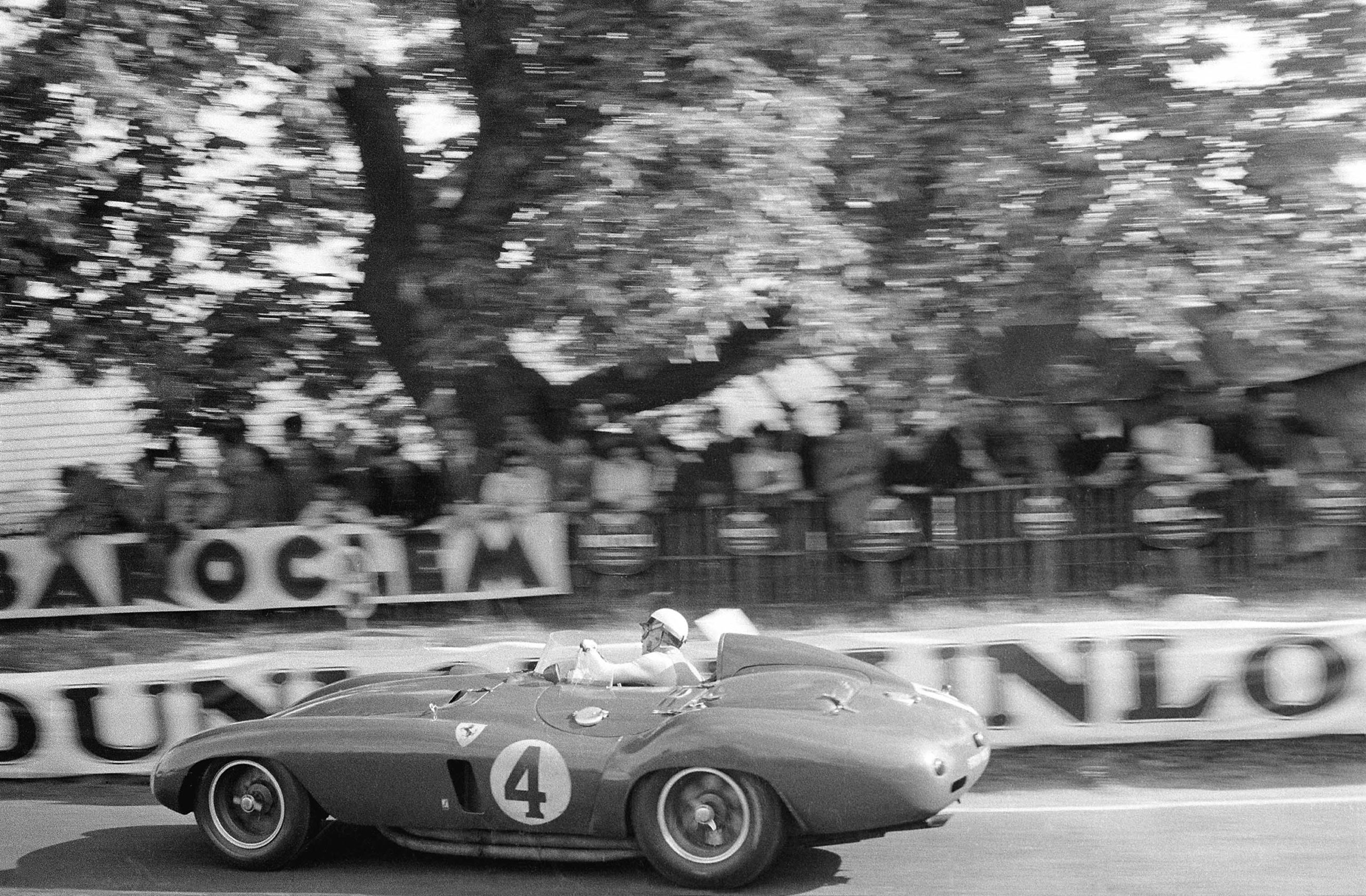 Italian driver Eugenio Castellotti at Tertre Rouge in the early laps of the 24 Hours of Le Mans race, June 1955. He shared this Ferrari 121LM with Paolo Marzotto. (Photo by Klemantaski Collection/Getty Images)
