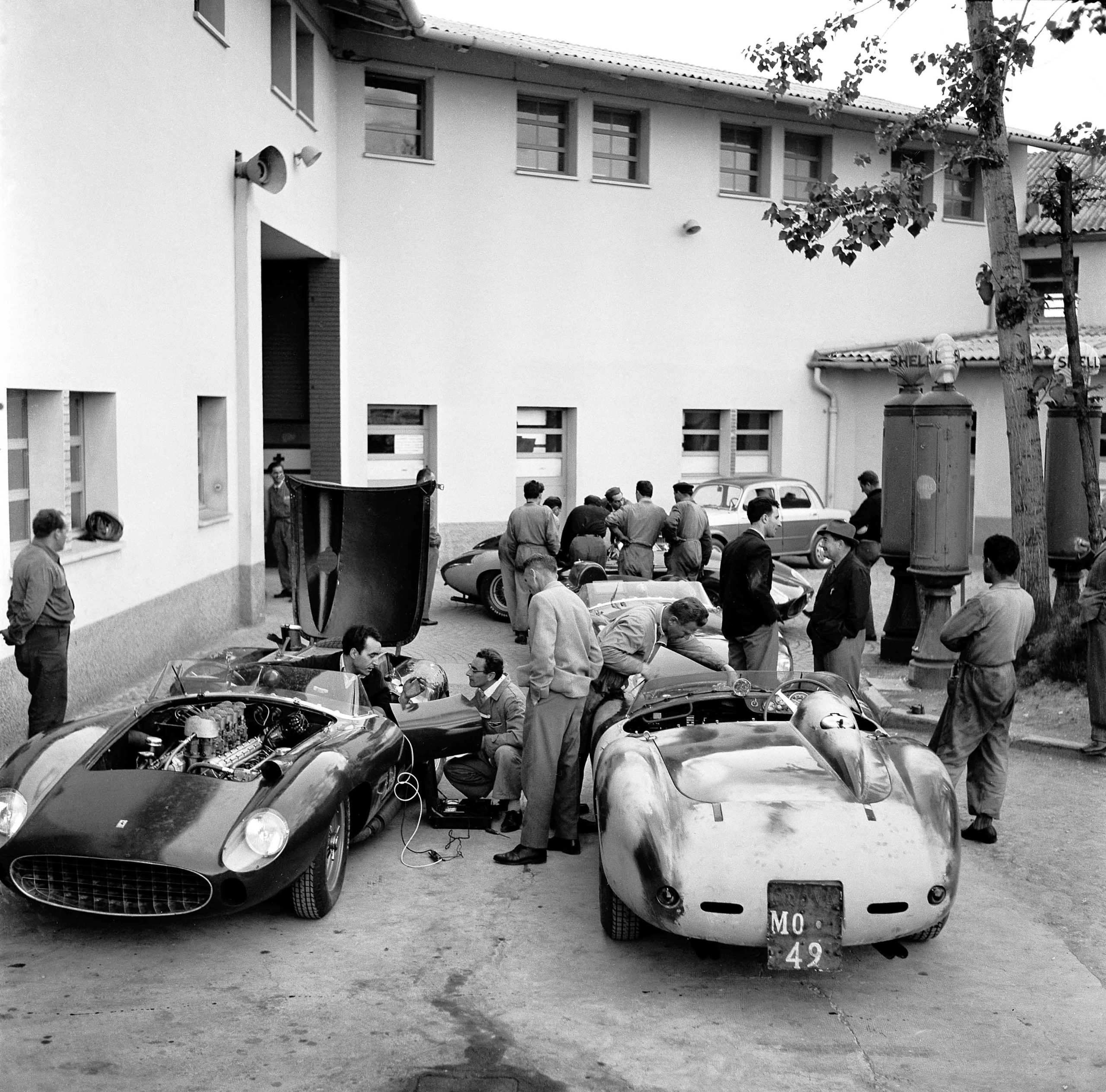 Before The Mille Miglia; Maranello, May 1957. The team cars (the famous type 315 and 335 Sport four-camshaft models to be driven by Taruffi, von Trips, Collins and de Portago) being prepared in the factory courtyard at Maranello with the Collins/Klemantaski car at the left. It is almost like a ballet in rehearsal. (Photo by Klemantaski Collection/Getty Images)