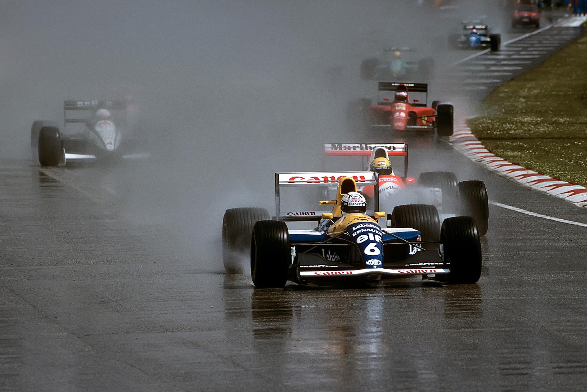 Riccardo Patrese leads at the start of the 1991 F1 San Marino Grand Prix at Imola
