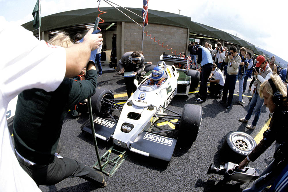 Keke Rosberg with his Williams FW08C-Ford Cosworth in the pits.