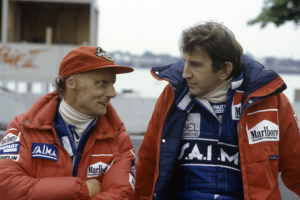 Niki Lauda speaks to team-mate John Watson.