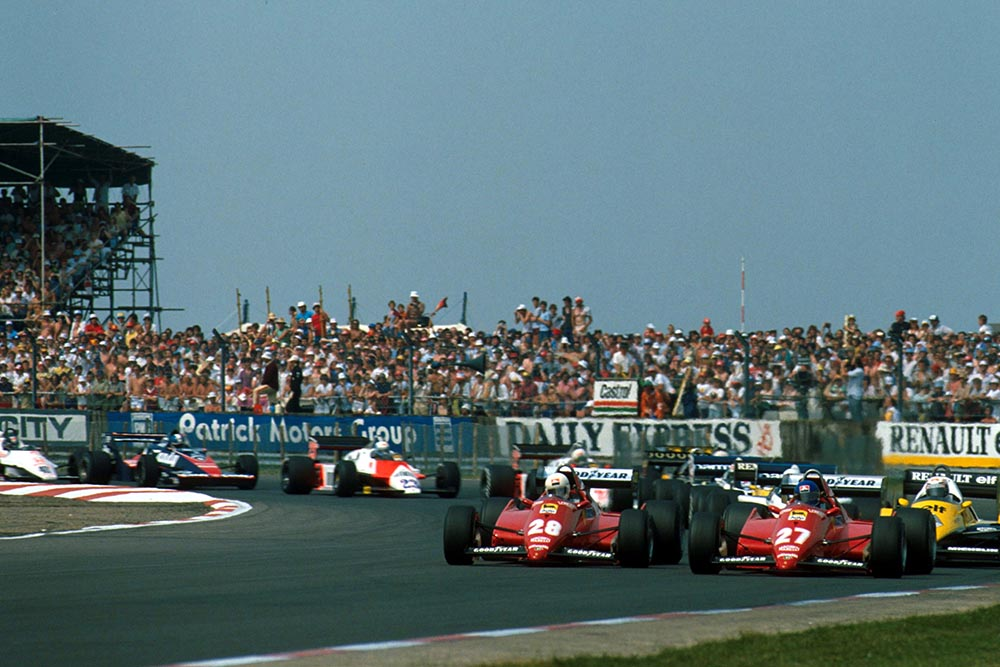 The two Ferrari's of Rene Arnoux, left, and Patrick Tambay lead the pack from a front row start.