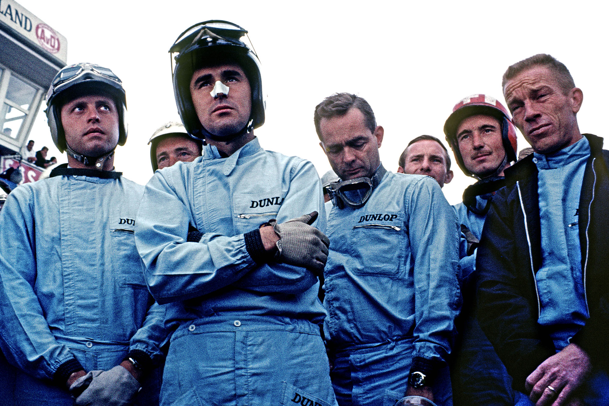 Giancarlo Baghetti (Scuderia Centro Sud BRM), Edgar Barth (Rob Walker Cooper-Climax), Lorenzo Bandini (Ferrari), Phil Hill (Cooper-Climax), Mike Hailwood (Parnell Lotus-BRM), Jo Siffert (privateer Brabham-BRM) and Richie Ginther (BRM) at the drivers briefing before the 1964 German Grand Prix at the Nurburgring.