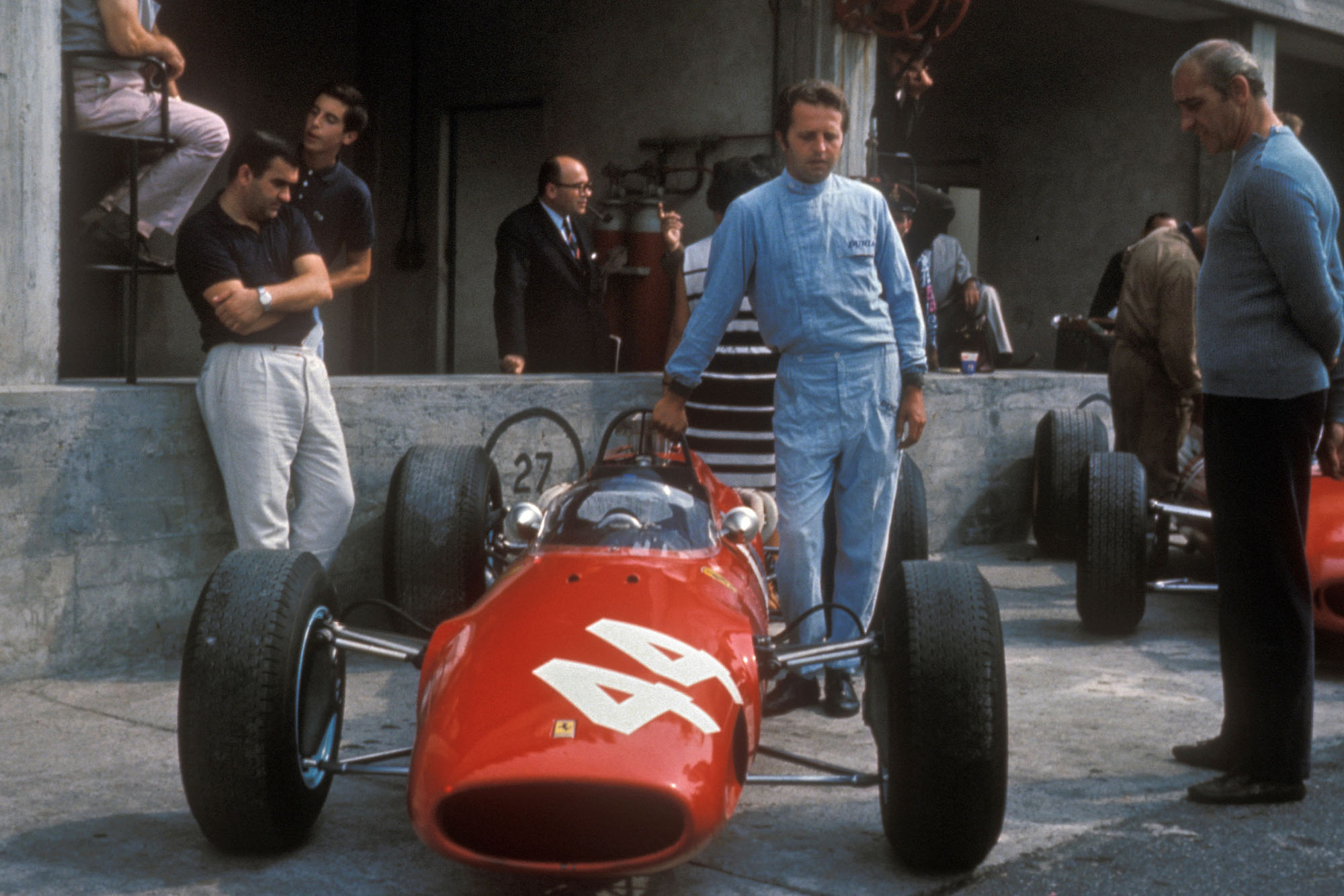 Giancarlo Baghetti with the Ferrari he drove for Reg Parnell in the 1966 Italian Grand Prix at Monza. The car was loaned to him by Ferrari.