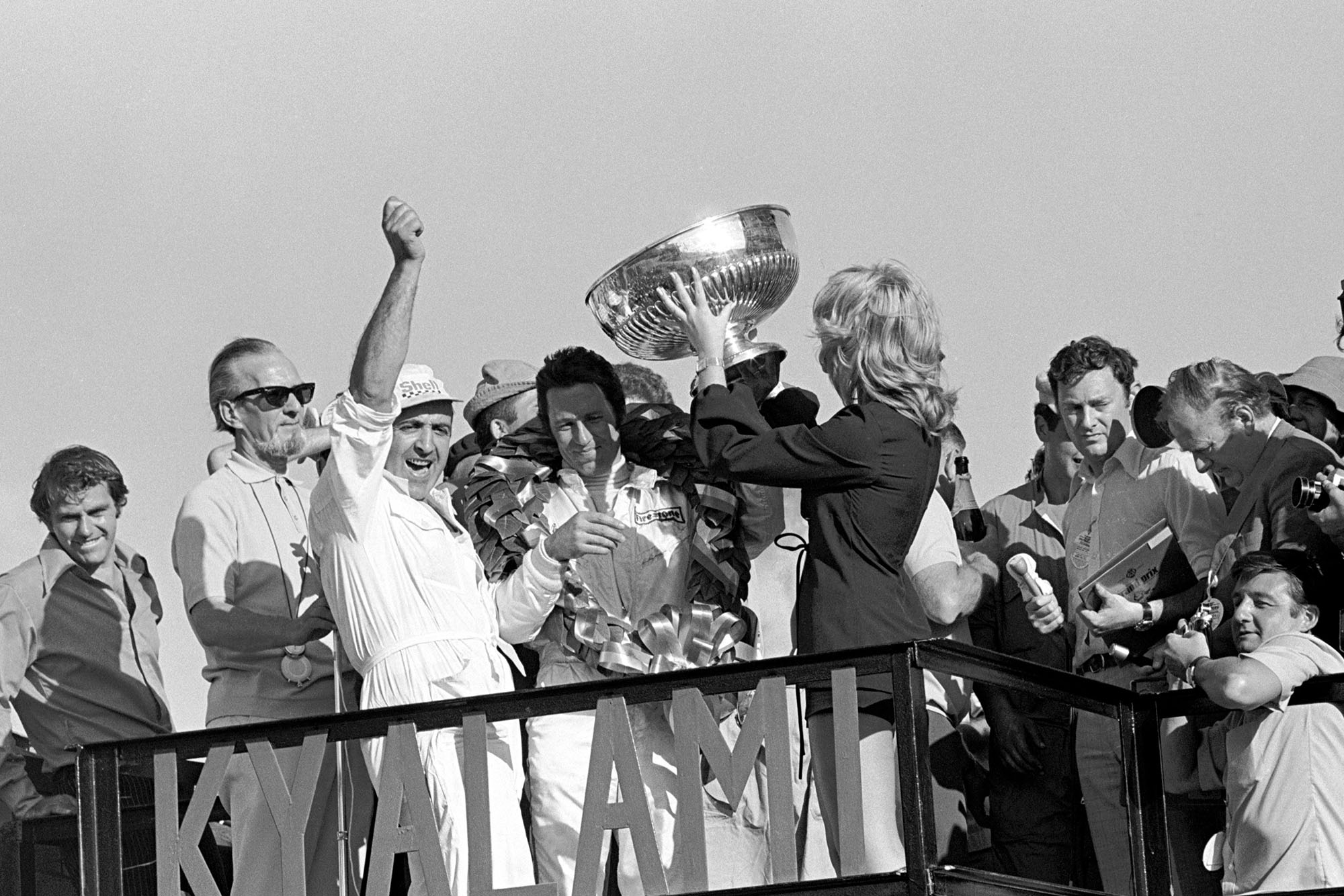 Mario Andretti celebrates on the podium after winning the 1971 South African Grand Prix.