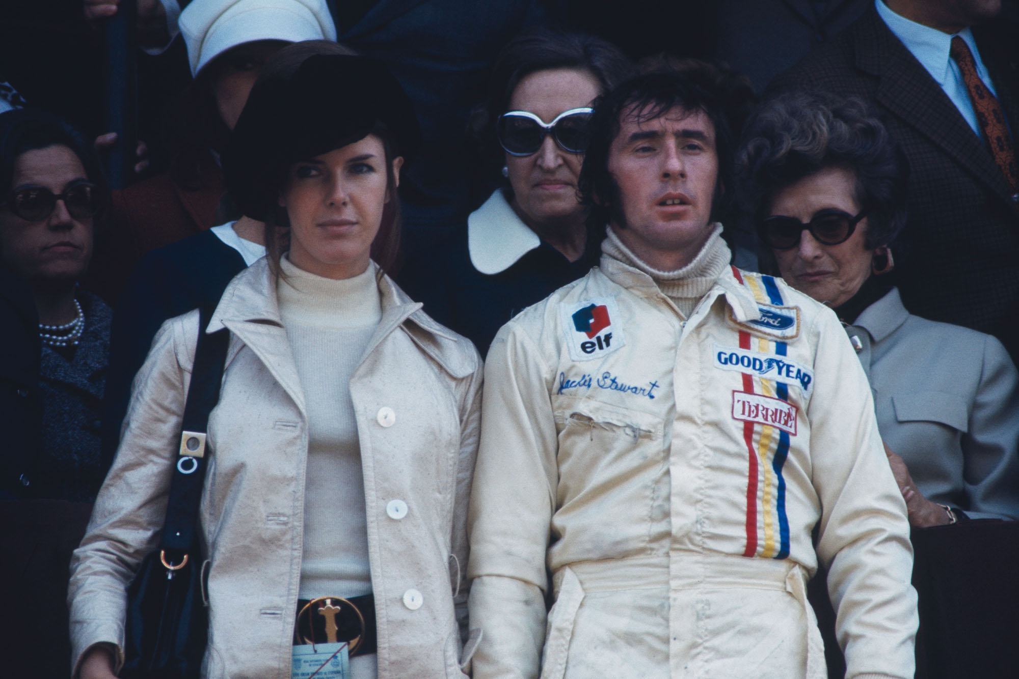 Jackie Stewart stands on the podium with his wife Helen after winning the 1971 Spanish Grand Prix