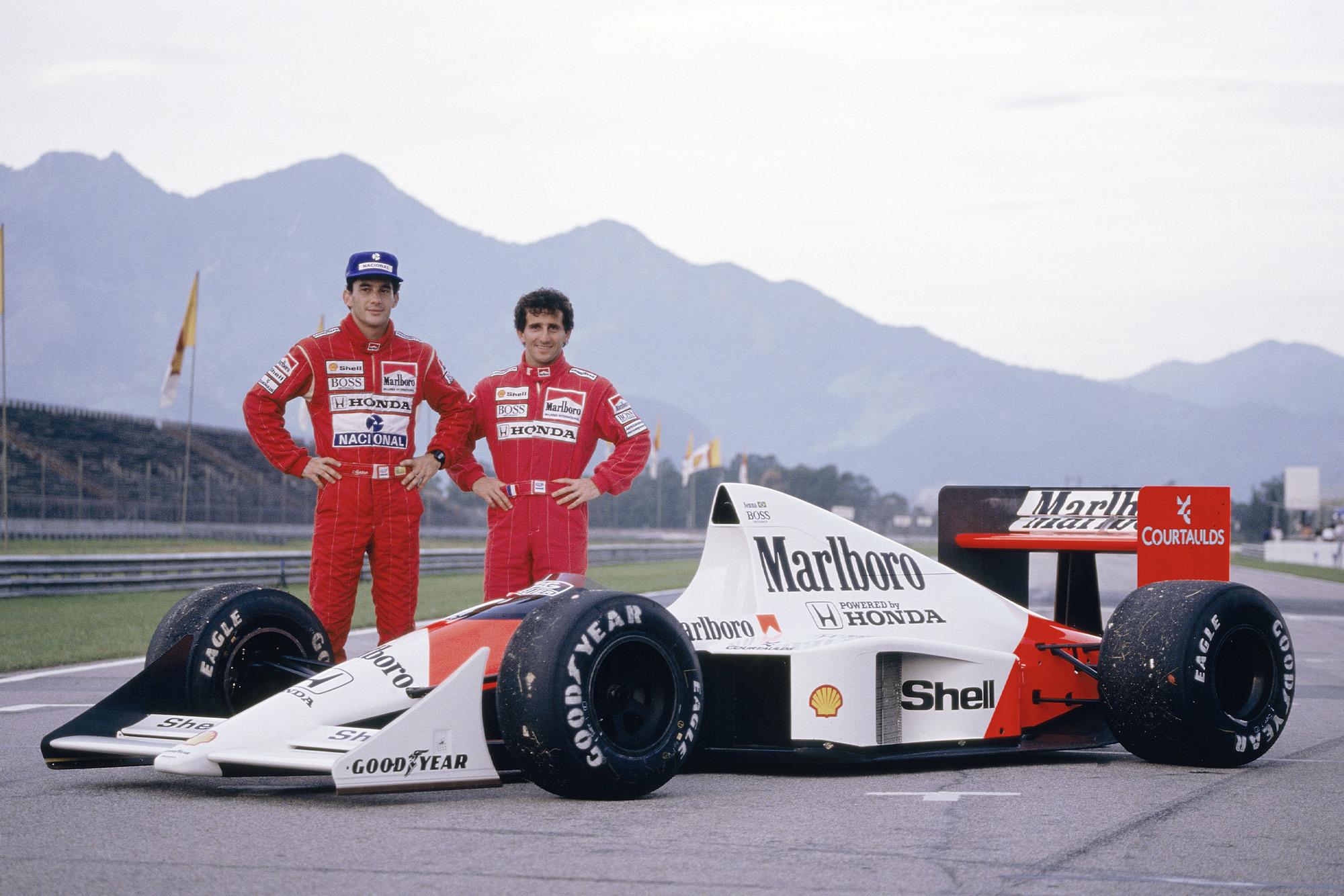 Ayrton Senna and Alain Prost stand next to their McLaren