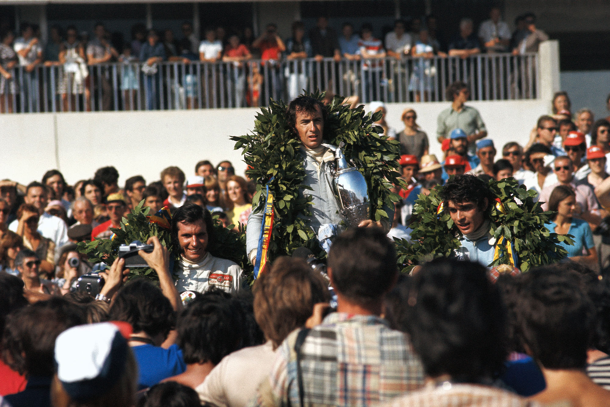 Jackie Stewart stands on the podium after winning the 1971 French Grand Prix.