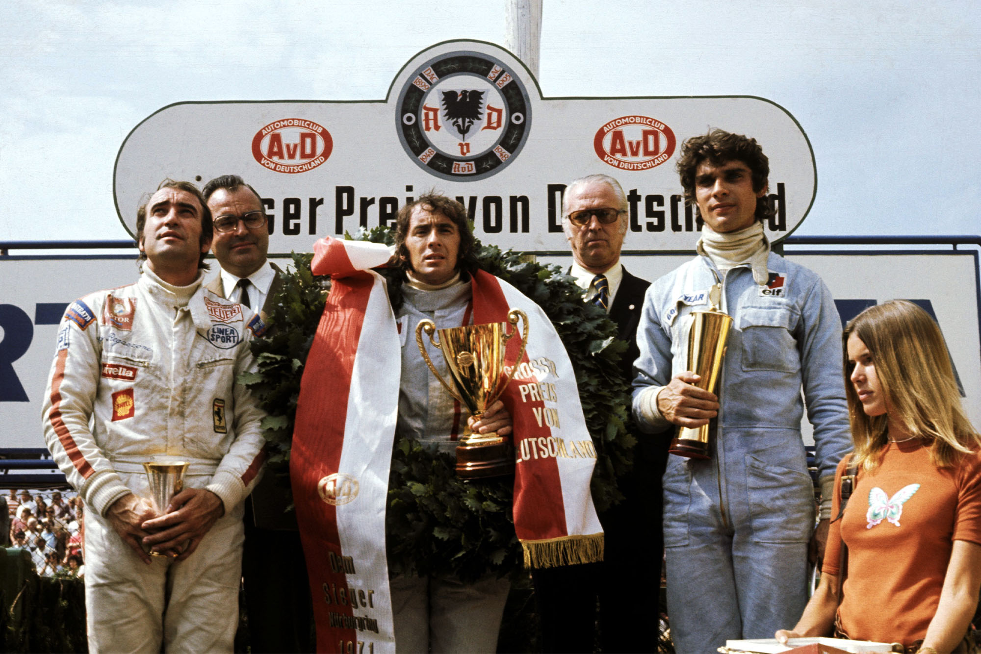 Jackie Stewart stands on the podium in between Clay Regazzoni (left) and Francois Cevert (right).