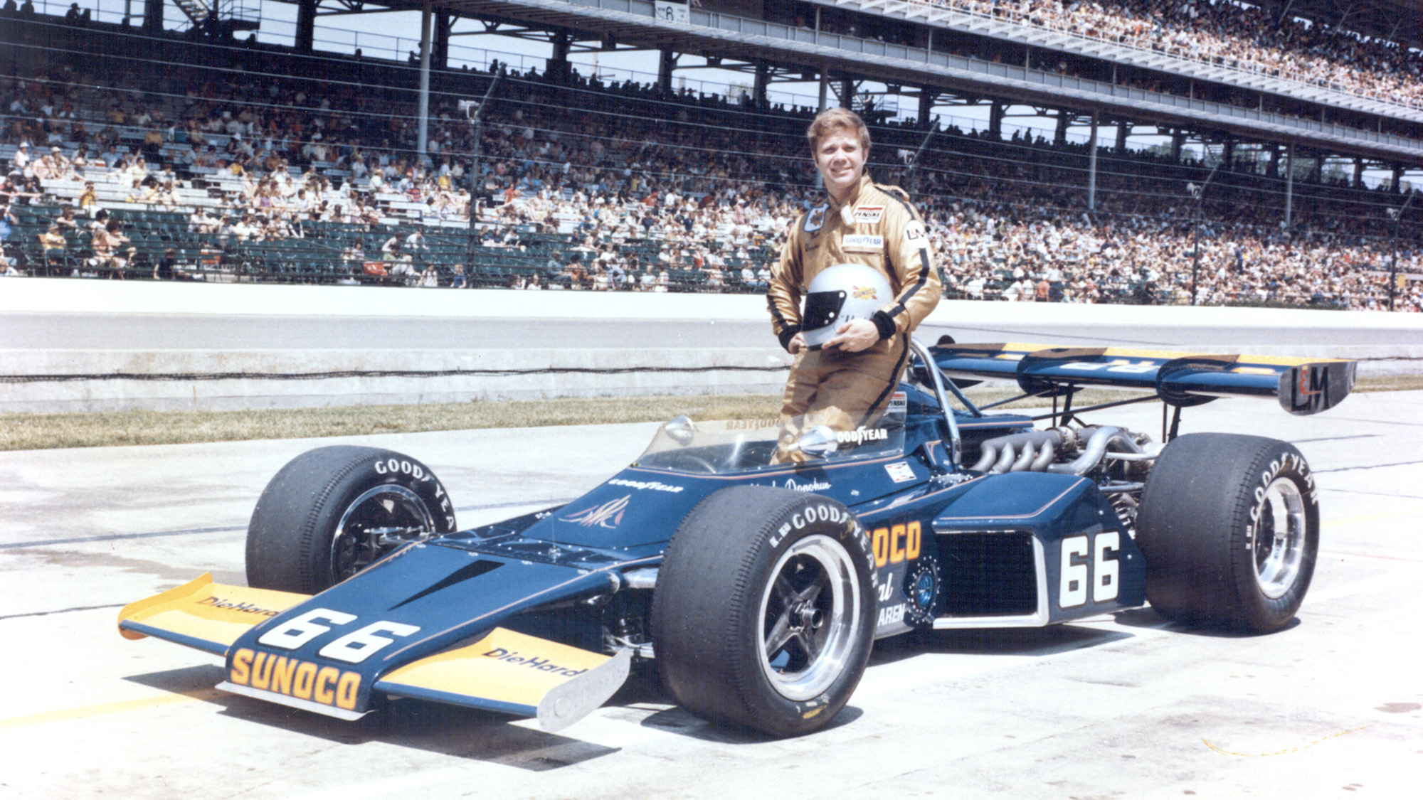 Mark Donohue poses next to his 1972 Indy 500-winning car