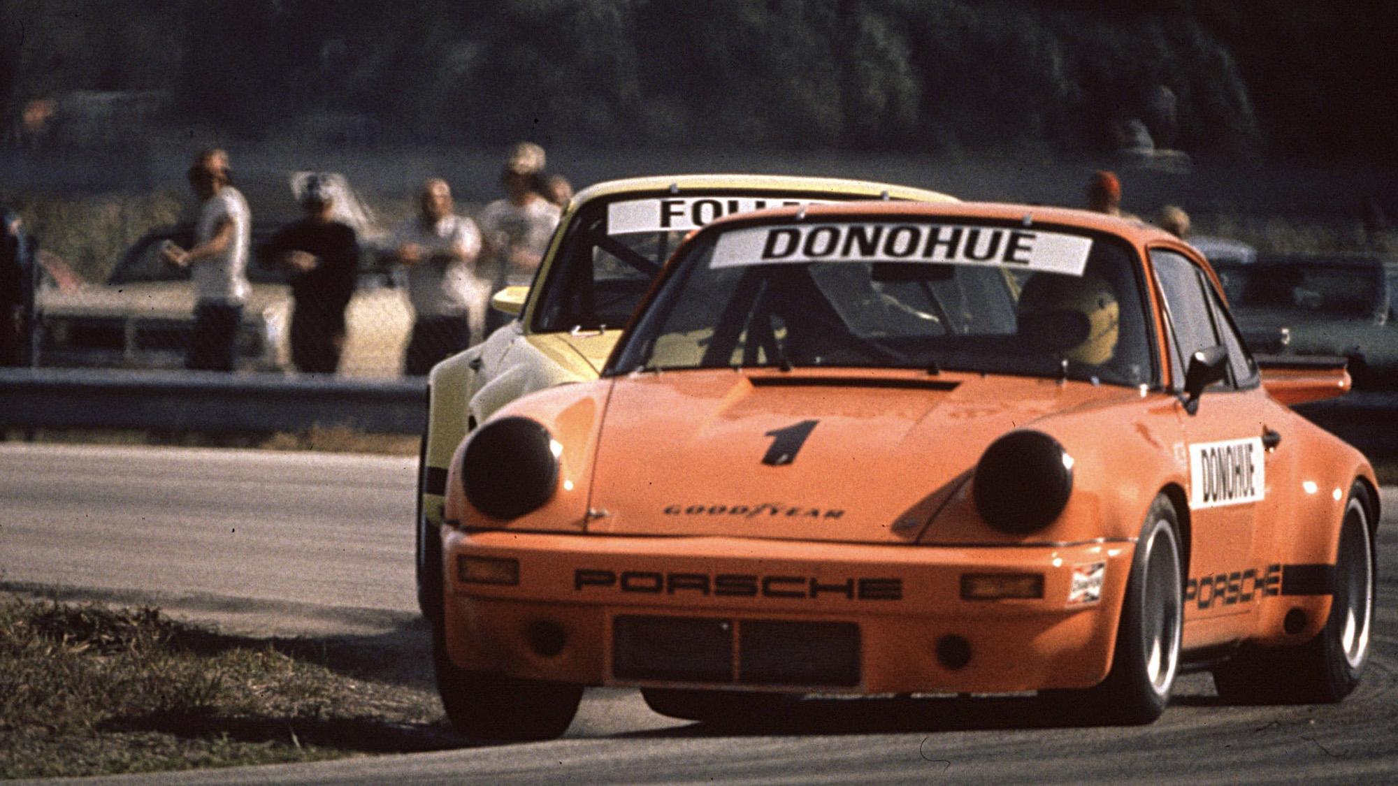 Mark Donohue racing an orange Porsche 911 RSR at Riverside in the 1973 International Race of Champions season