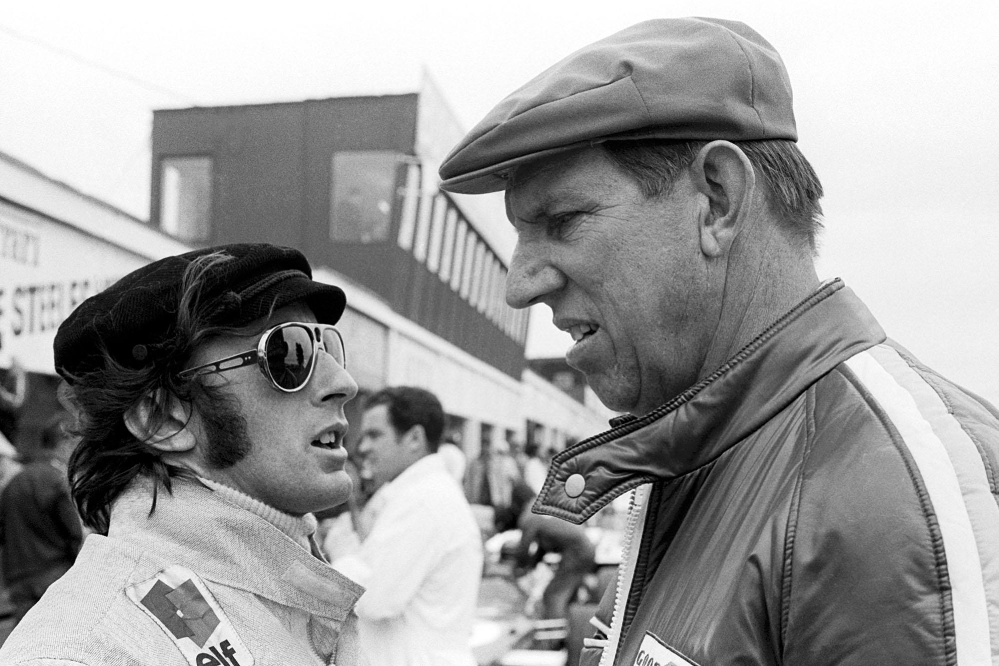 Jackie Stewart confers with team boss Ken Tyrrell.