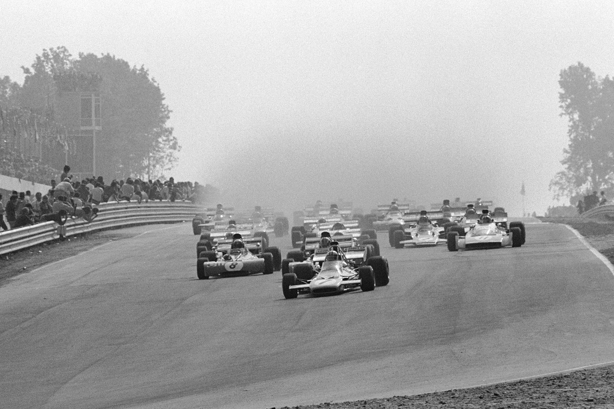 The 1971 United States Grand Prix gets underway in wet conditions.