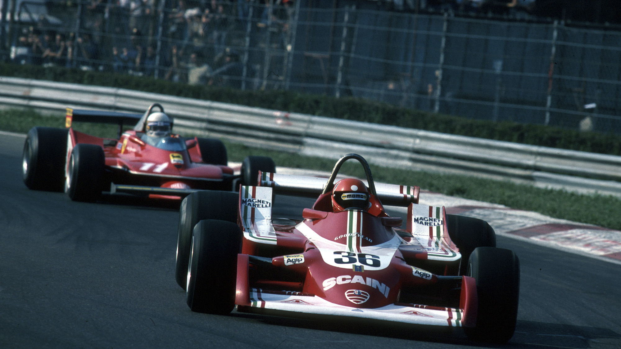 Vittorio Brambilla's Alfa Romeo leads the ferrari of Jody Scheckter during the 1979 Italian Grand Prix at Monza