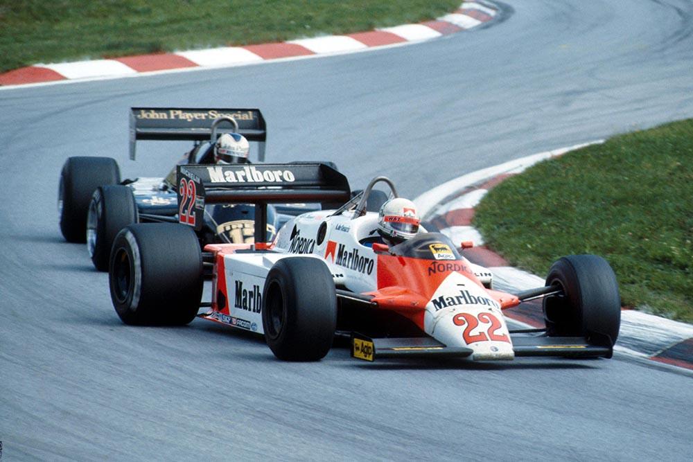 Andrea de Cesaris, Alfa Romeo, leads Nigel Mansell, Lotus.