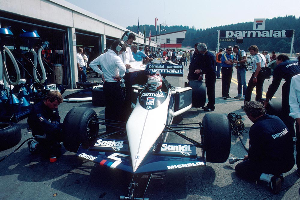 The Brabham of Nelson Piquet recieves some attention from his mechanics in the pits.