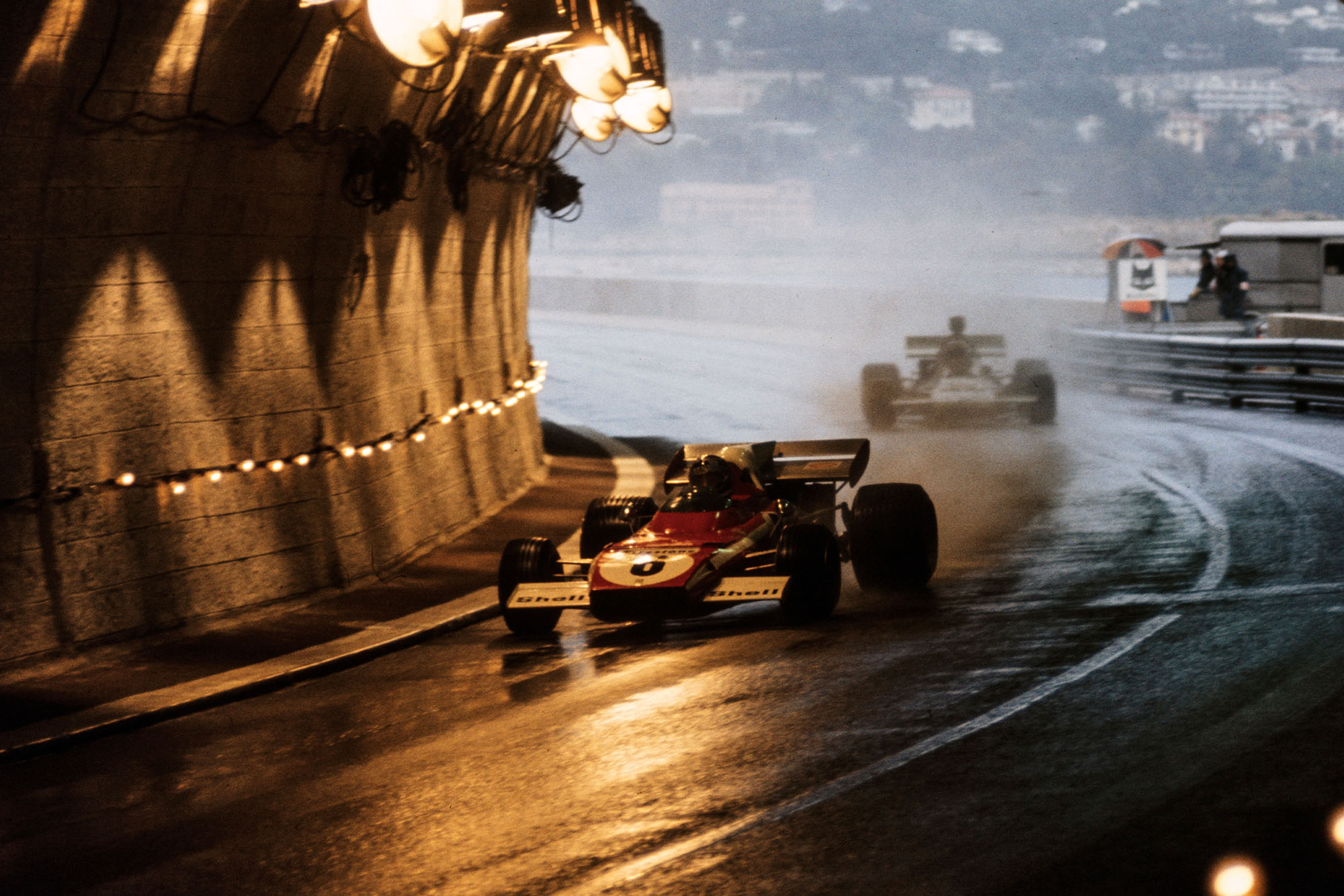 Ferrari's Jacky Ickx blasts through the tunnel in wet conditions at the 1972 Monaco Grand Prix.