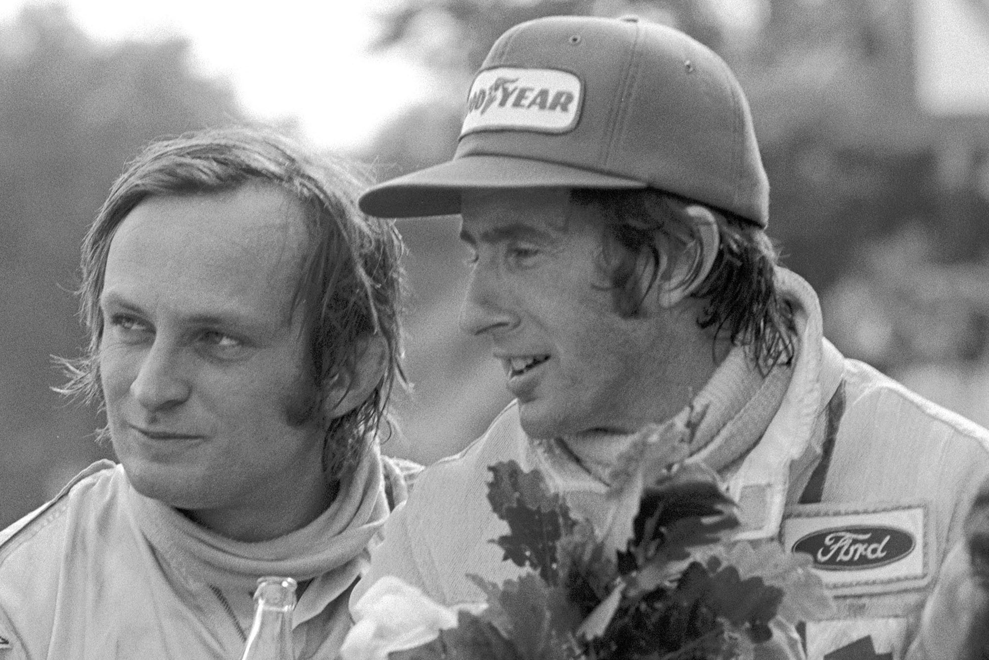 Jackie Stewart and Chris Amon celebrate on the podium at the 1972 French Grand Prix.