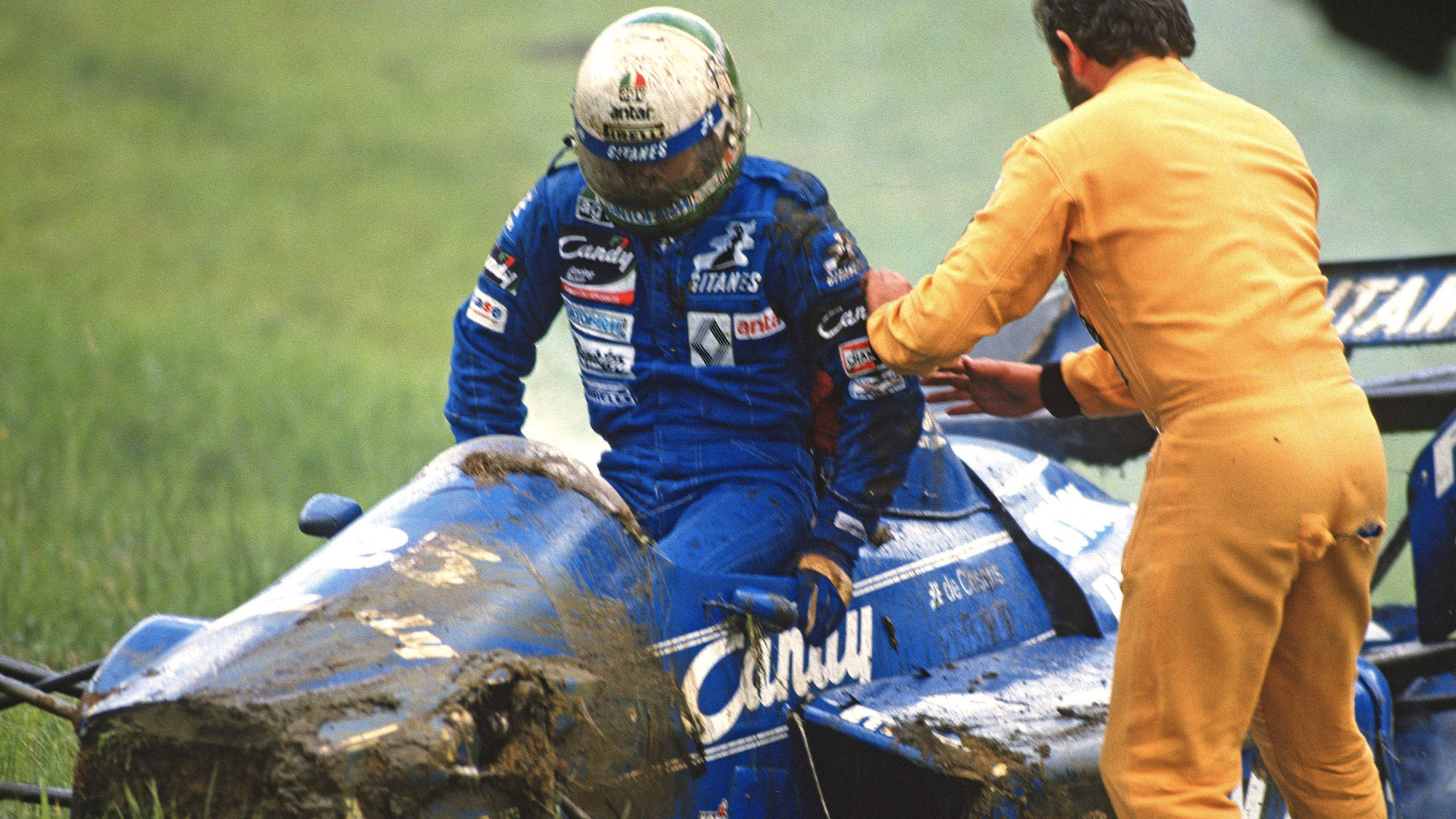 Andrea de Cesaris gets out of his Ligier after crashing in the 1985 Austrian Grand Prix