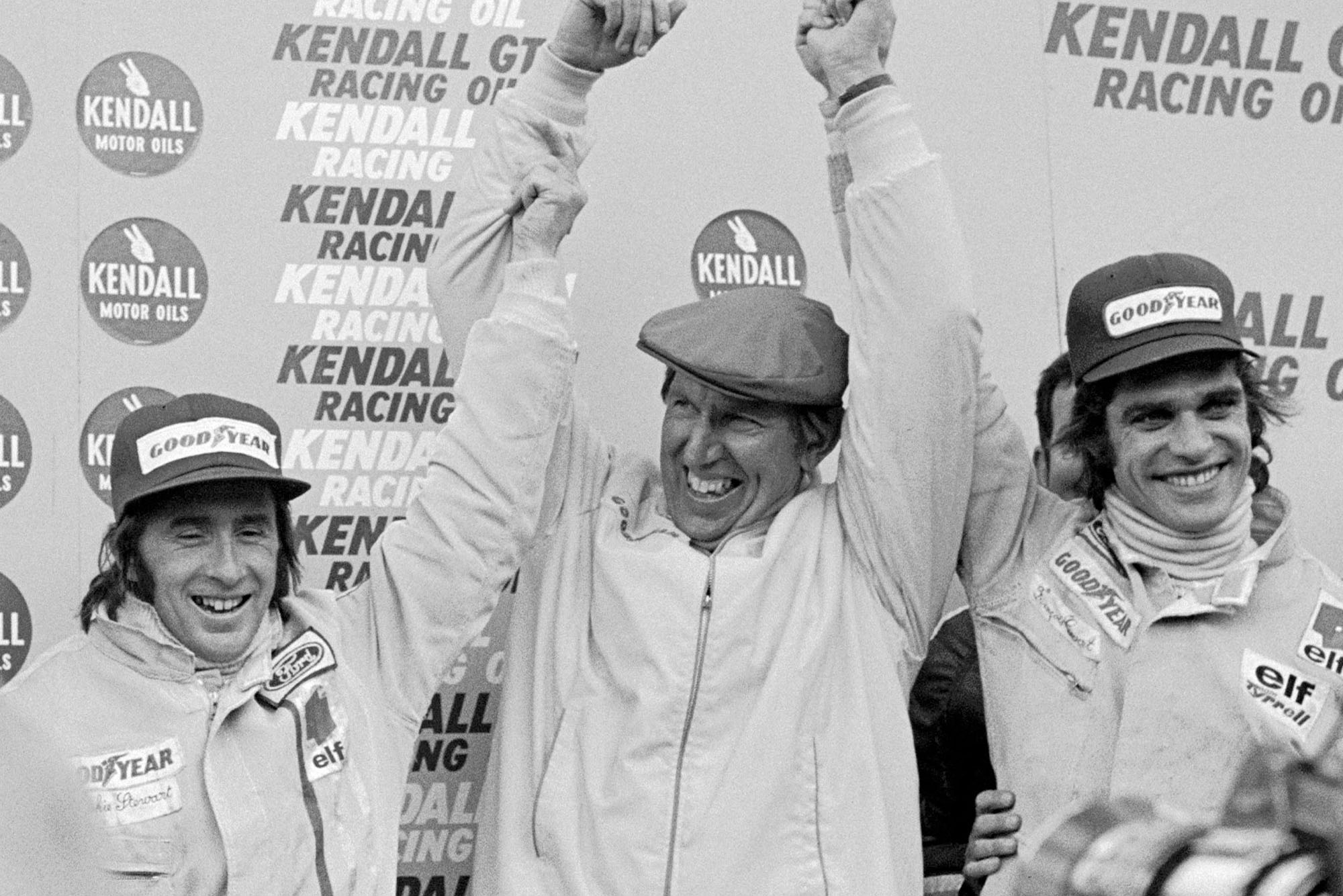 Jackie Stewart (left), Ken Tyrrell (centre) and Francois Cevert (right) celebrate their victory at the 1972 United States Grand Prix, Watkins Glen.