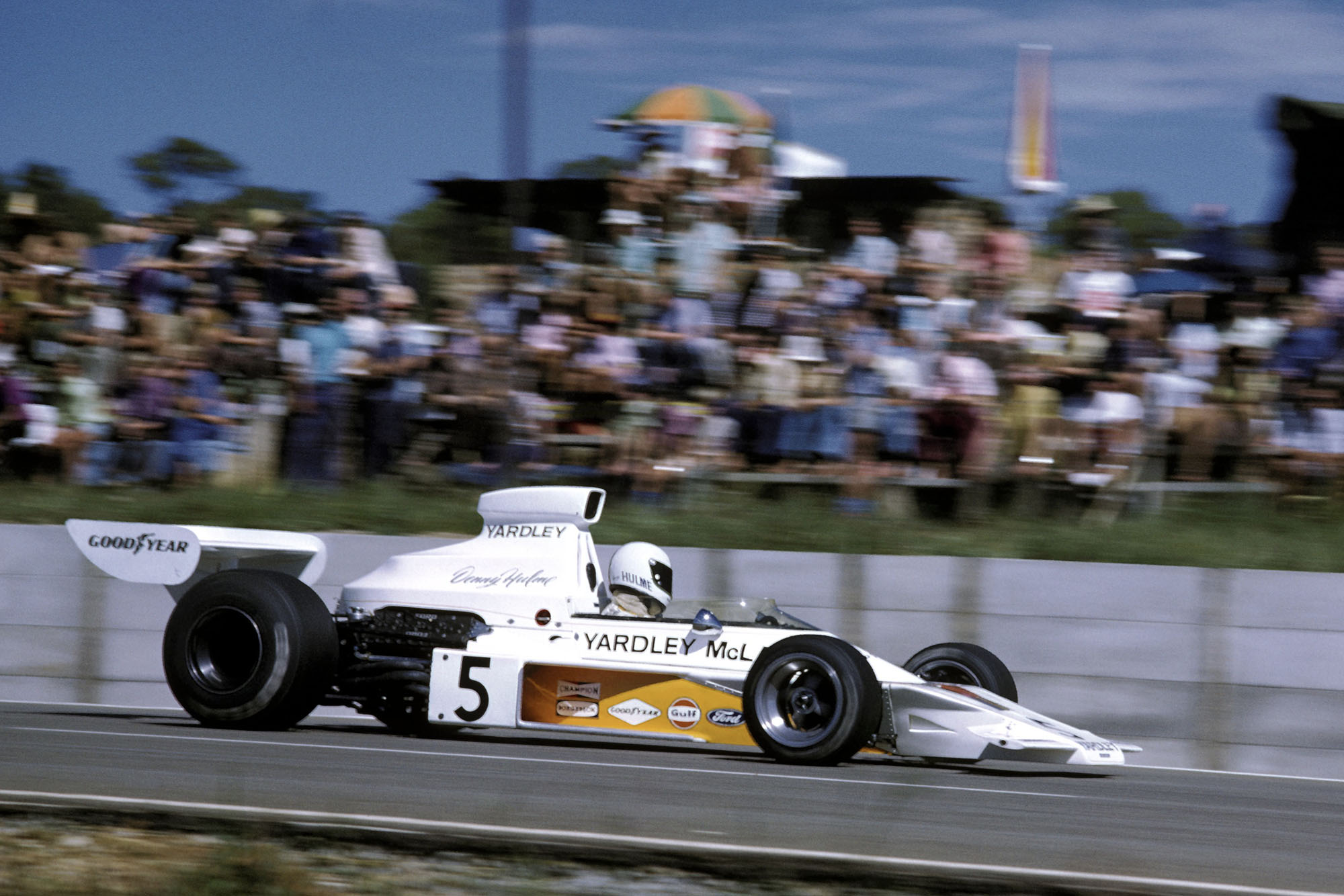 Denny Hulme (McLaren) driving at the 1973 South African Grand Prix, Kyalami.