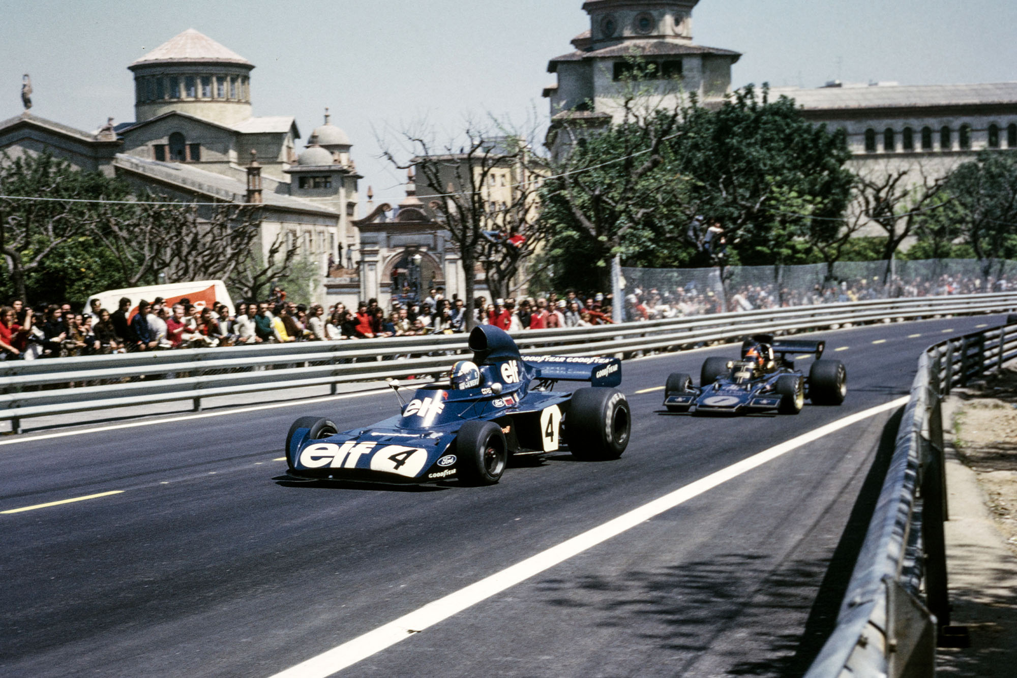 Emerson Fittipaldi chases Stewart at the 1973 Spanish Grand Prix, Montjuïch Park.