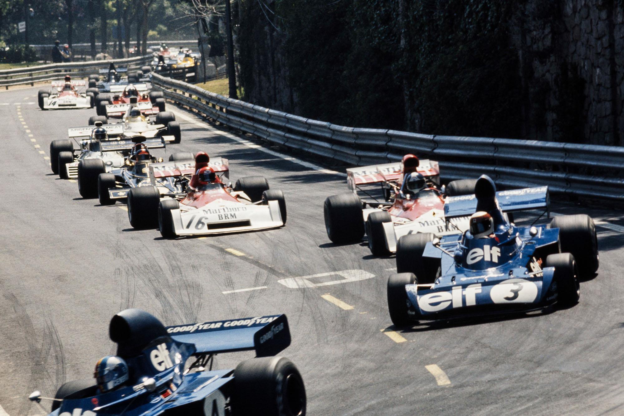 Cars thread through the narrow street circuit of Montjuïch Park at the 1973 Spanish Grand Prix.