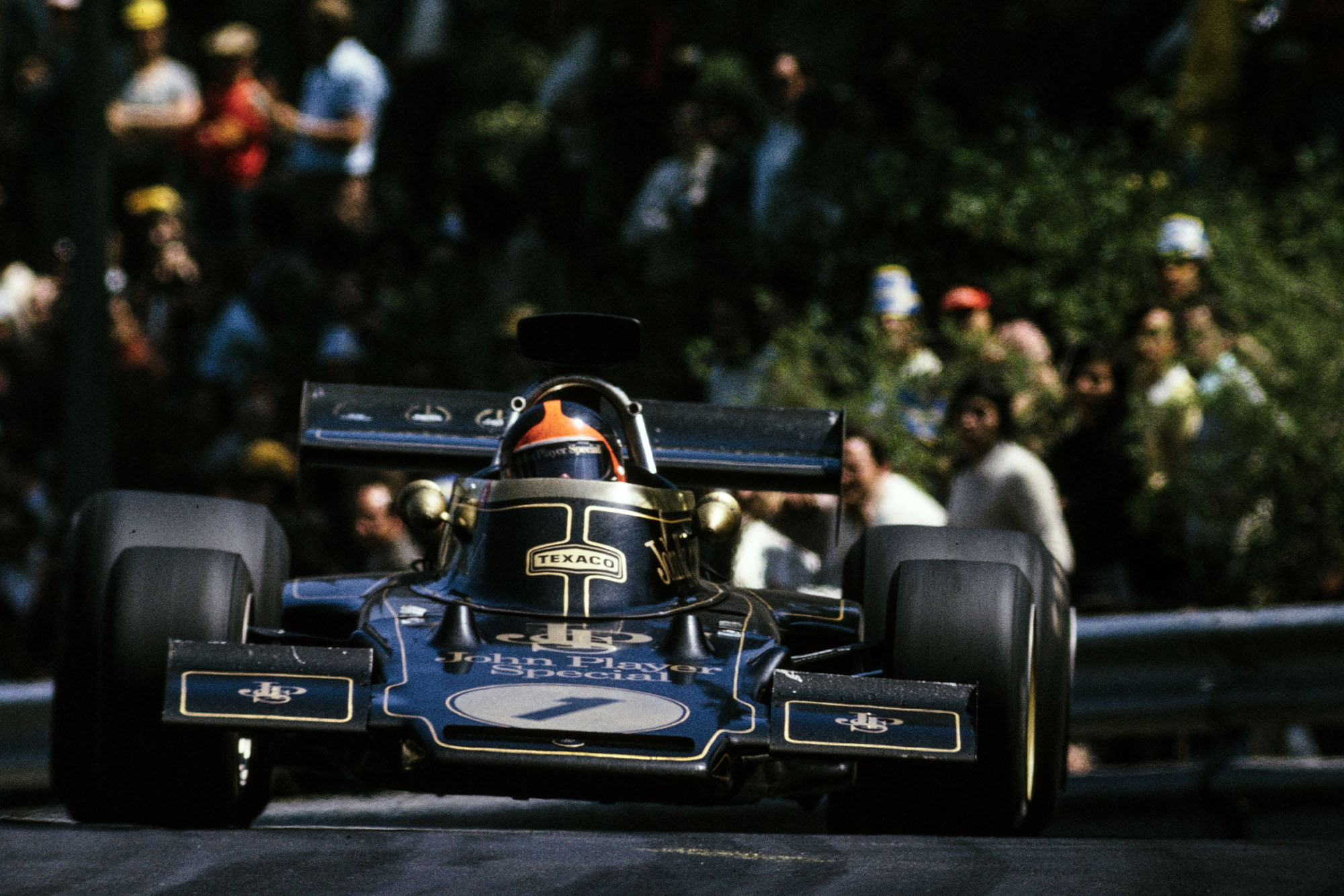 Emmerson Fittipaldi pushing in his Lotus at the 1973 Spanish Grand Prix.