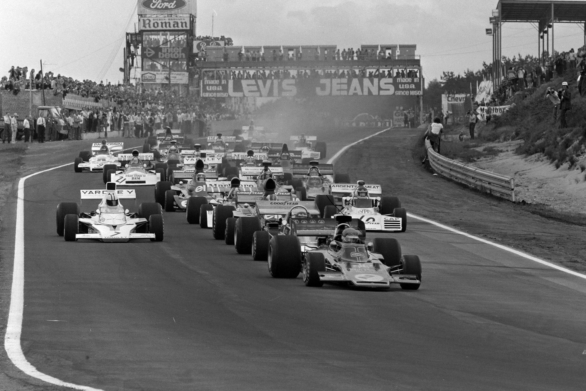 Ronnie Peterson leads the field into the first corner at the 1973 Belgian Grand Prix
