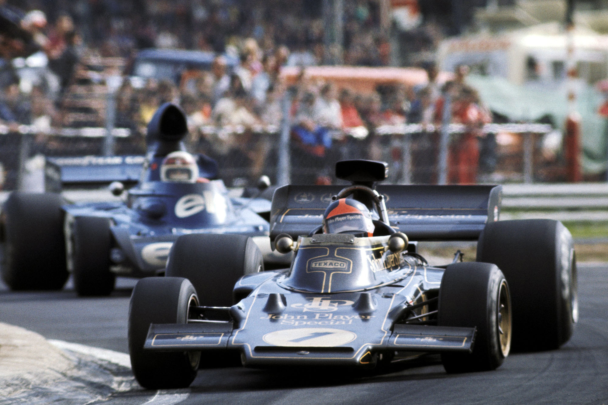 Emerson Fittipaldi (Lotus) is chased by Jackie Stewart (Tyrrell) at the 1973 Belgian Grand Prix.