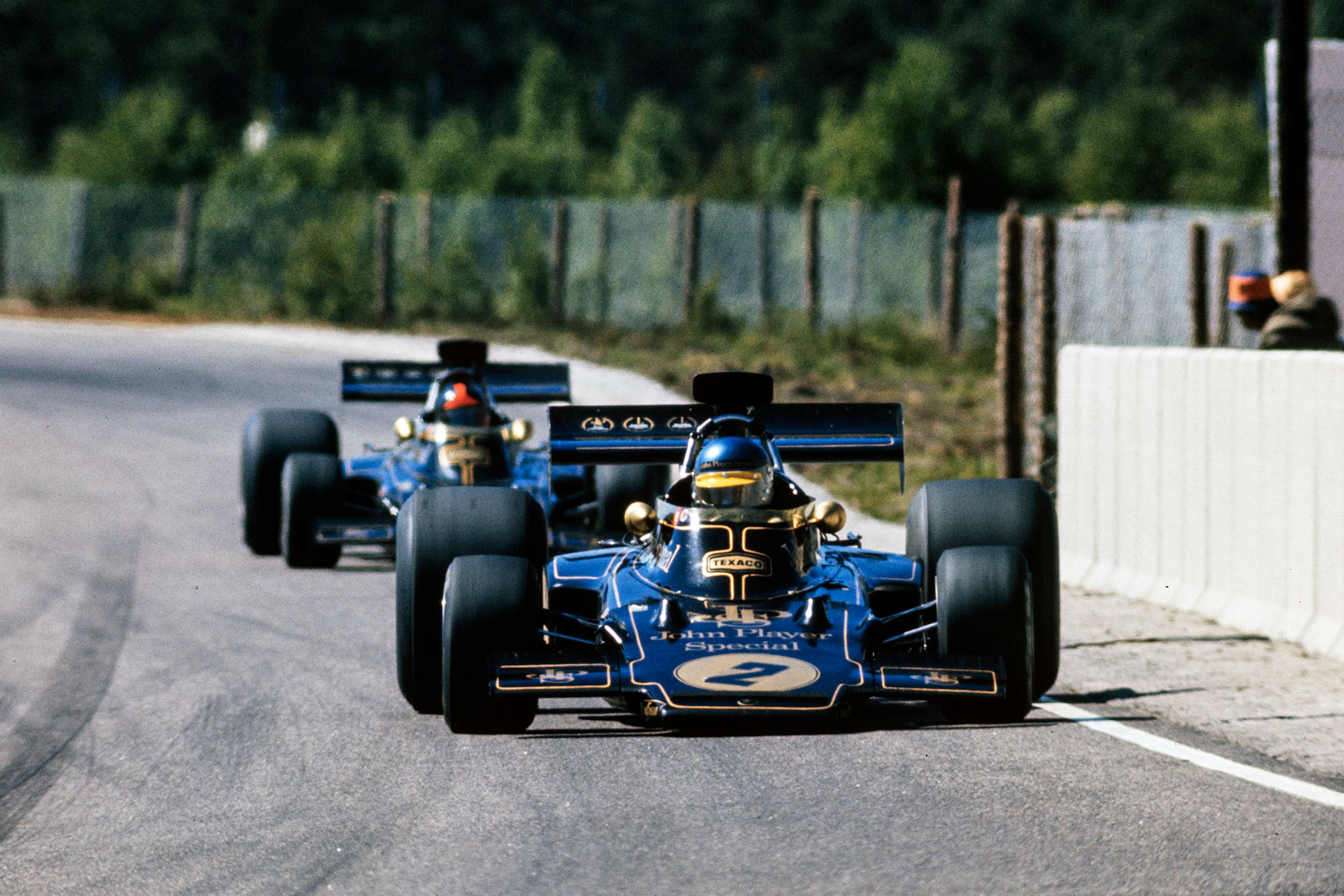Ronnie Peterson leads Lotus team-mate Emerson Fittipaldi