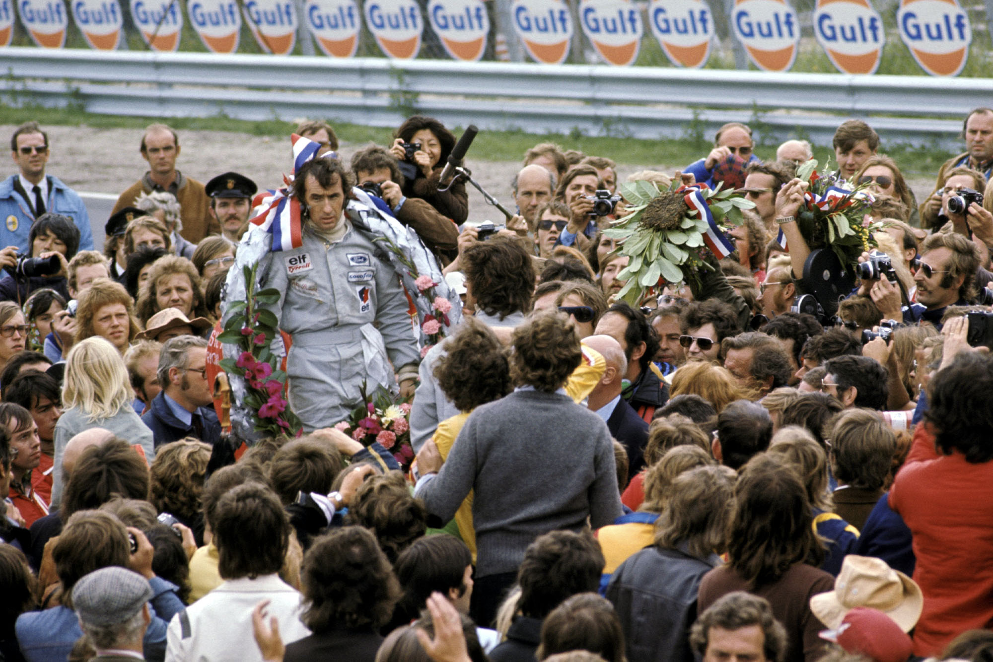 Jack Stewart stands on the podium after winning the 1973 Dutch Grand Prix, Zandvoort.