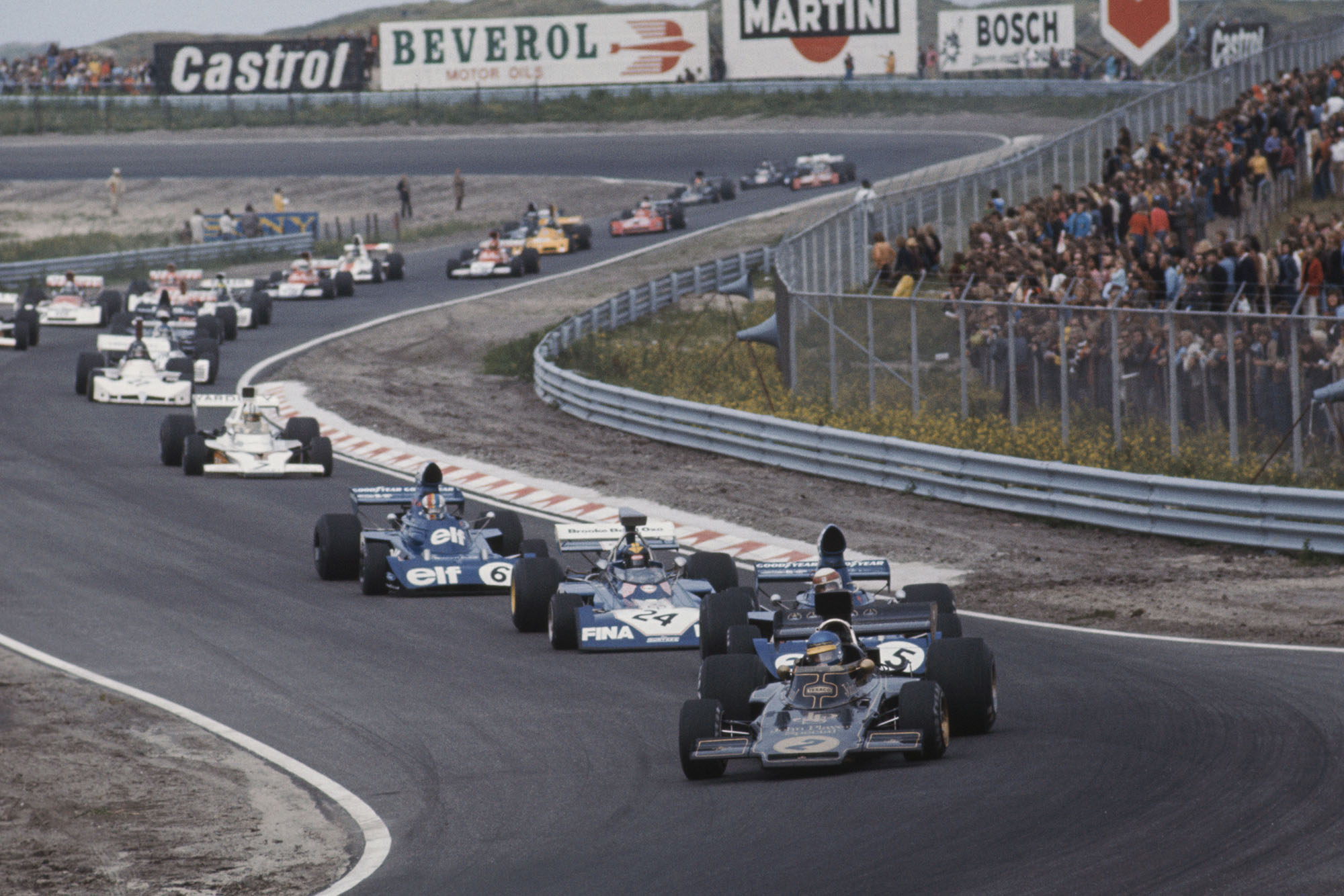 Lotus driver Ronnie Peterson leads the field on the opening lap of the 1973 Dutch Grand Prix, Zandvoort.