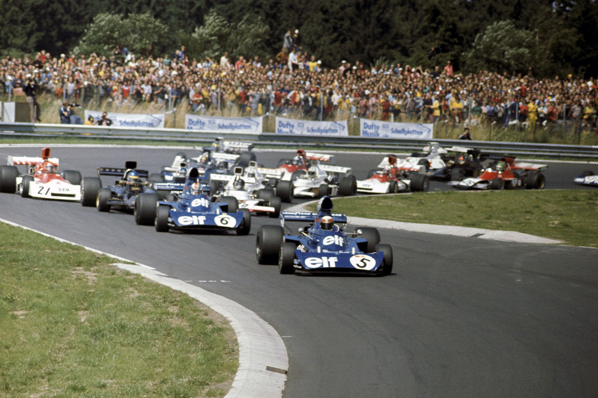 Jackie Stewart (Tyrrell) leads the field out of the first corner of the 1973 german Grand Prix, Nurburgring.