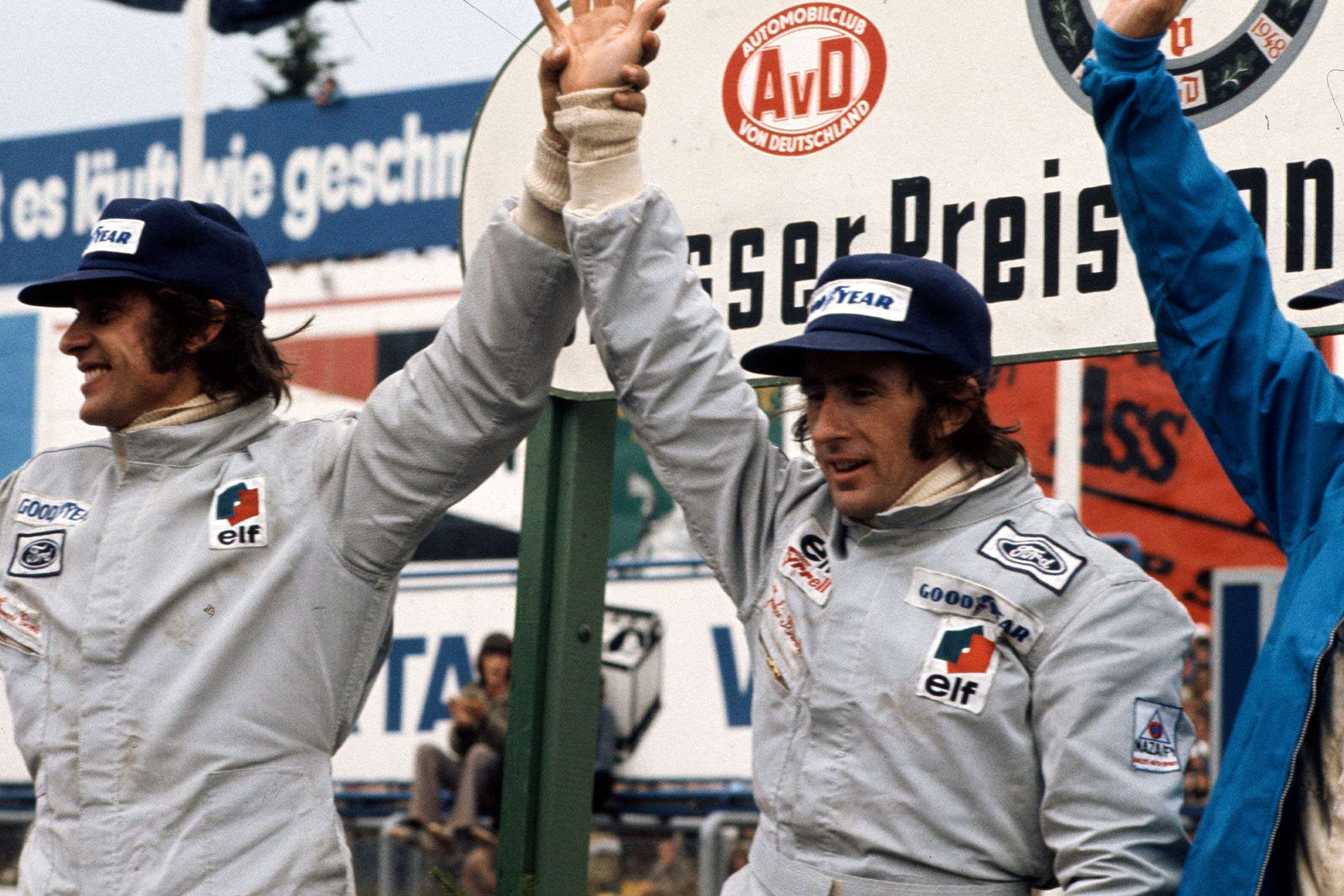 Tyrell drivers Francois Cevert (left) and Jackie Stewart celebrate on the podium.