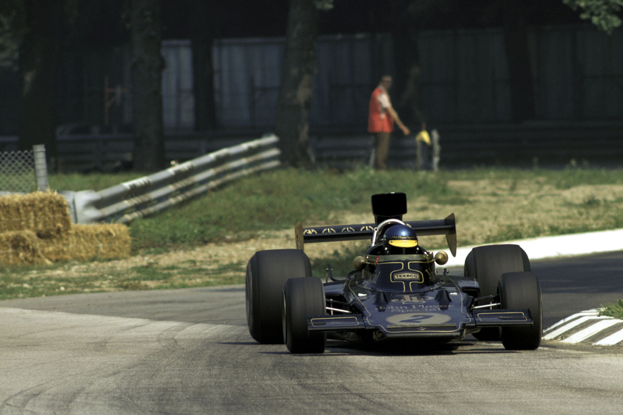 Ronnie Peterson slides through the chicane in Lotus at the 1973 Italian Grand Prix, Monza.