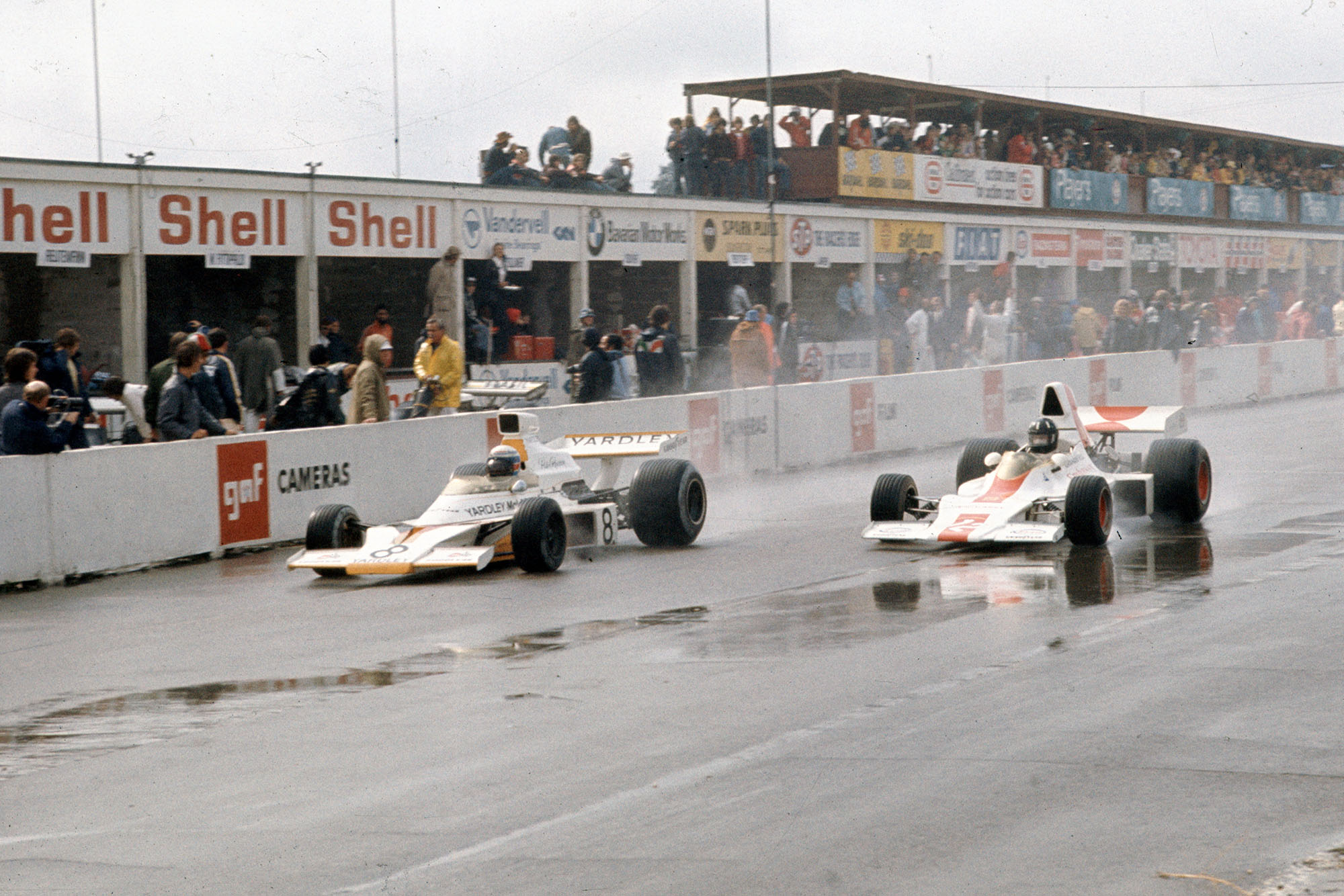 Peter Revson passes Graham Hill at the 1973 Canadian Grand Prix, Mosport Park.