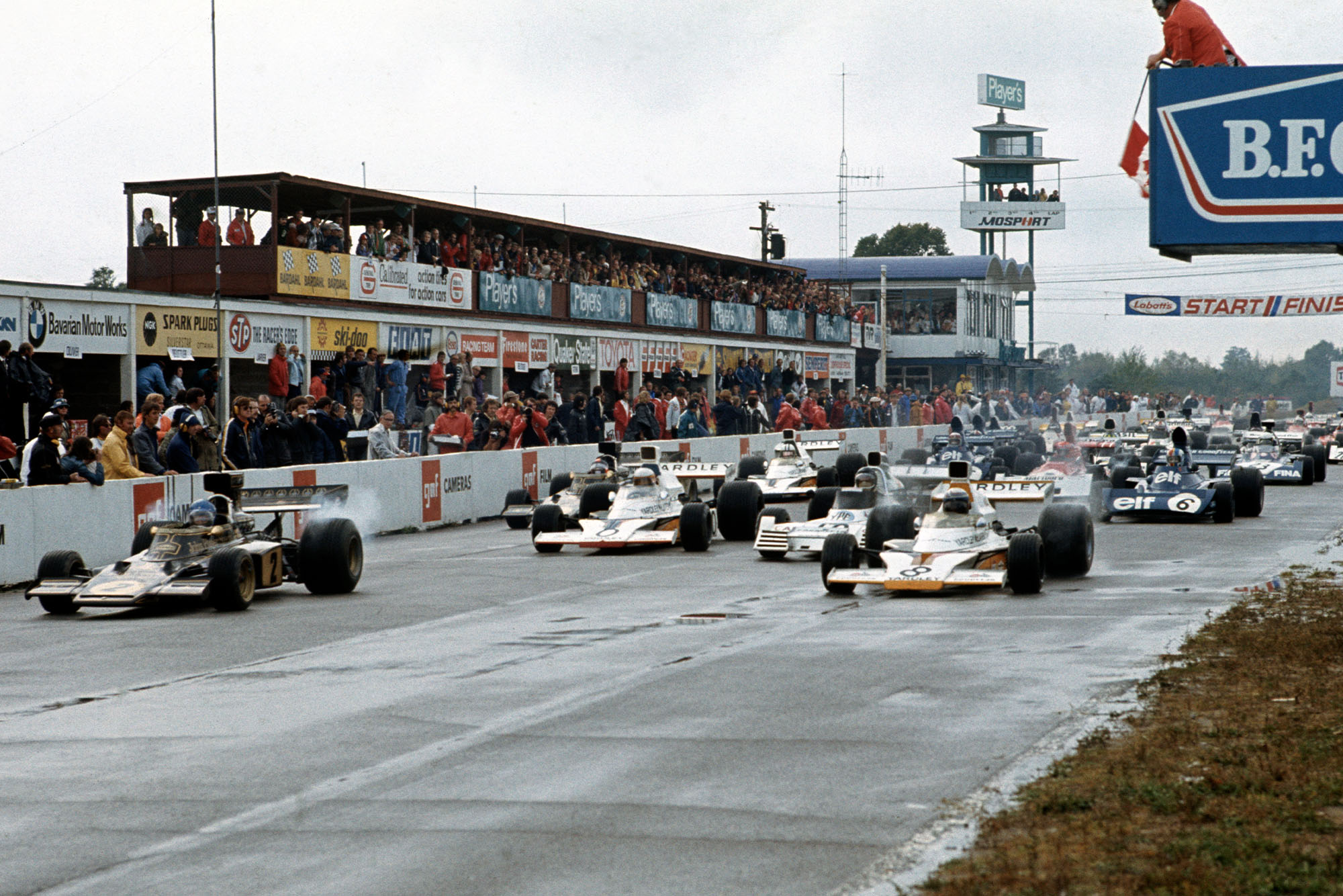 The cars pull away on a wet grid at the 1973 Canadian Grand Prix, Mosport Park.