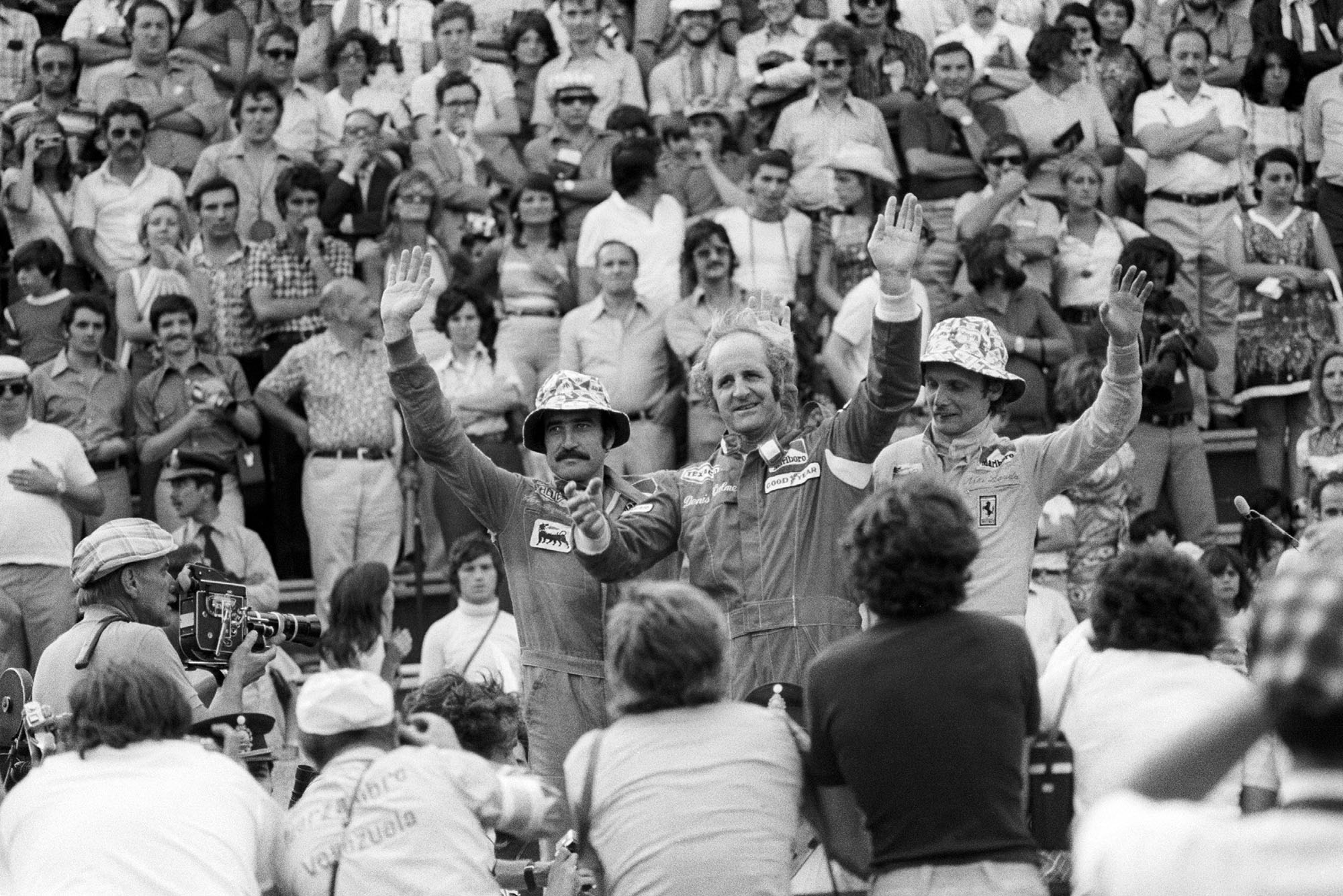 Denny Hulme waves from the podium after winning the 1974 Argentine Grand Prix.