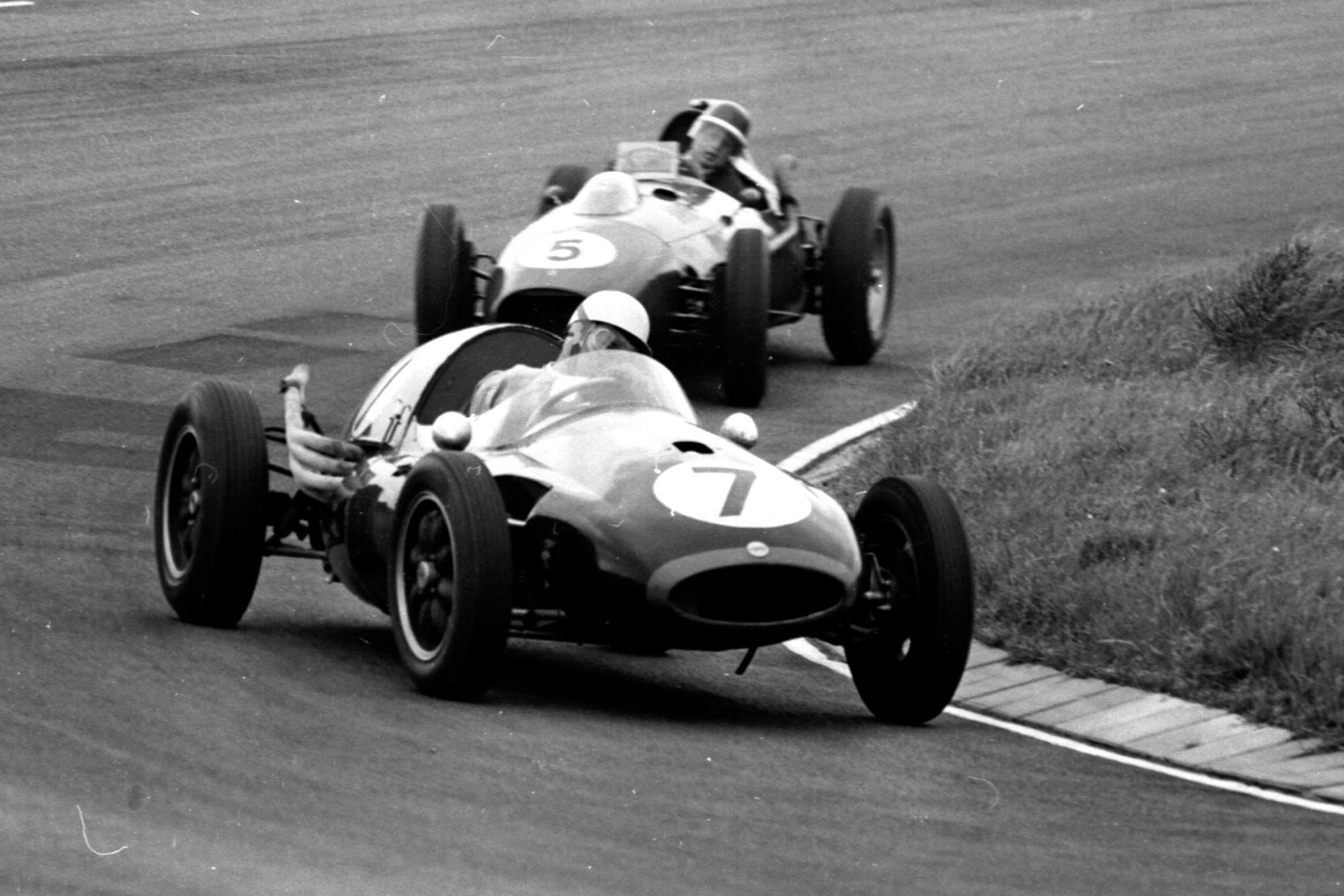 Roy Salvadori driving a Cooper T45 Climax ahead of Mike Hawthorn in a Ferrari Dino 246