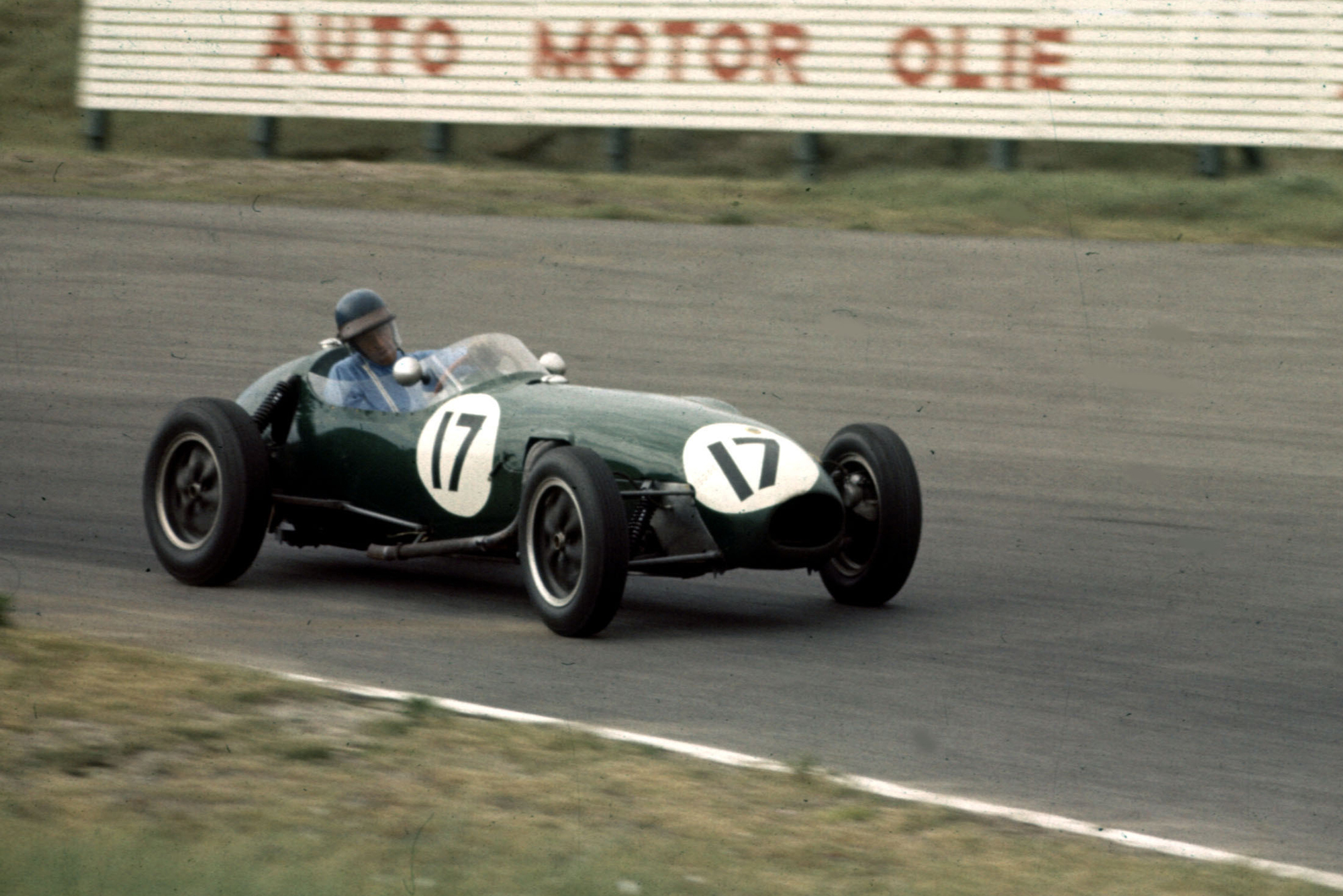 6th place finisher Cliff Allison in a Lotus 12-Climax